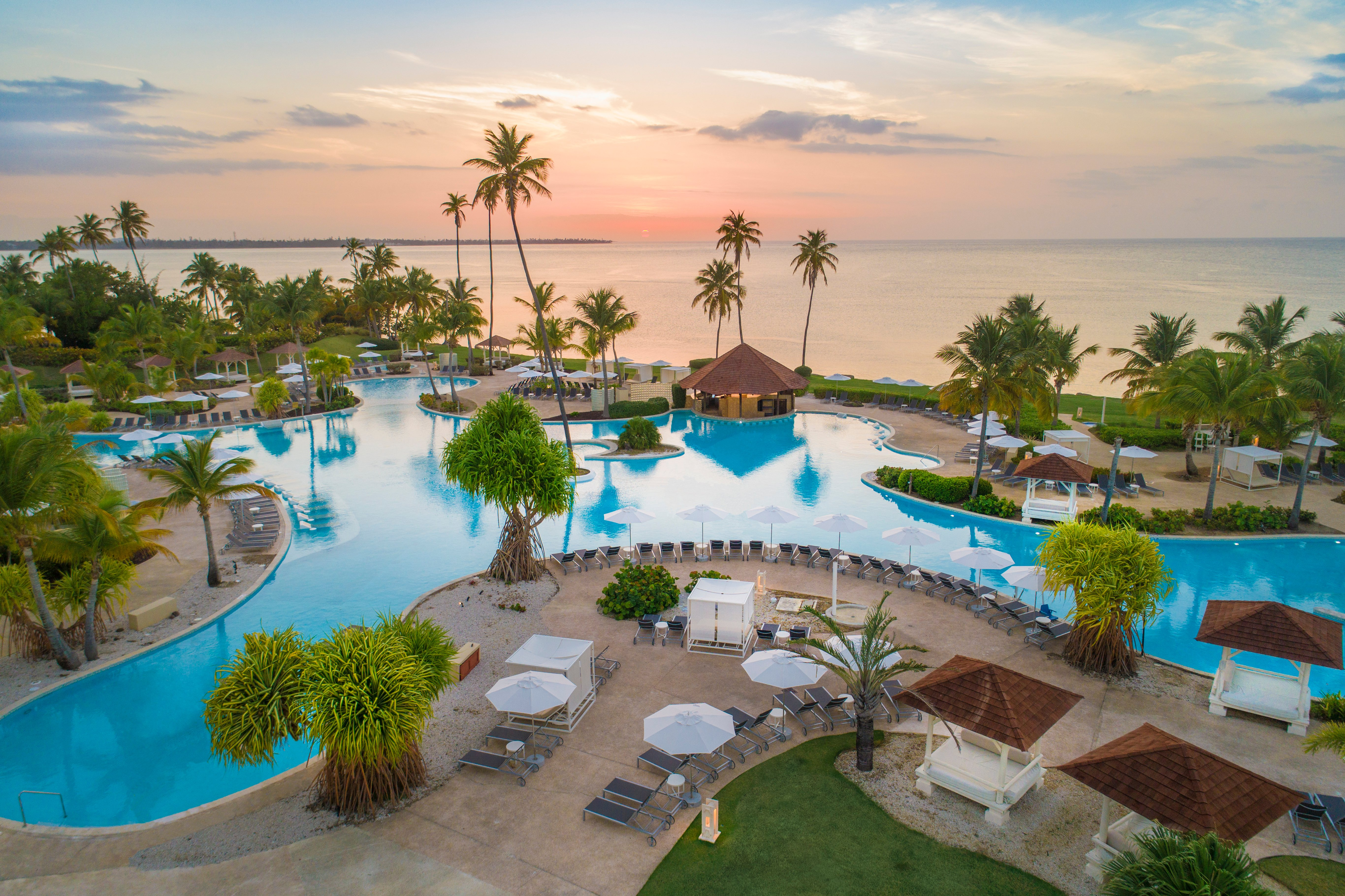 Among the property's four swimming pools is the largest lagoon-style pool in Puerto Rico as well as a swim-up bar with in-pool lounge chairs.