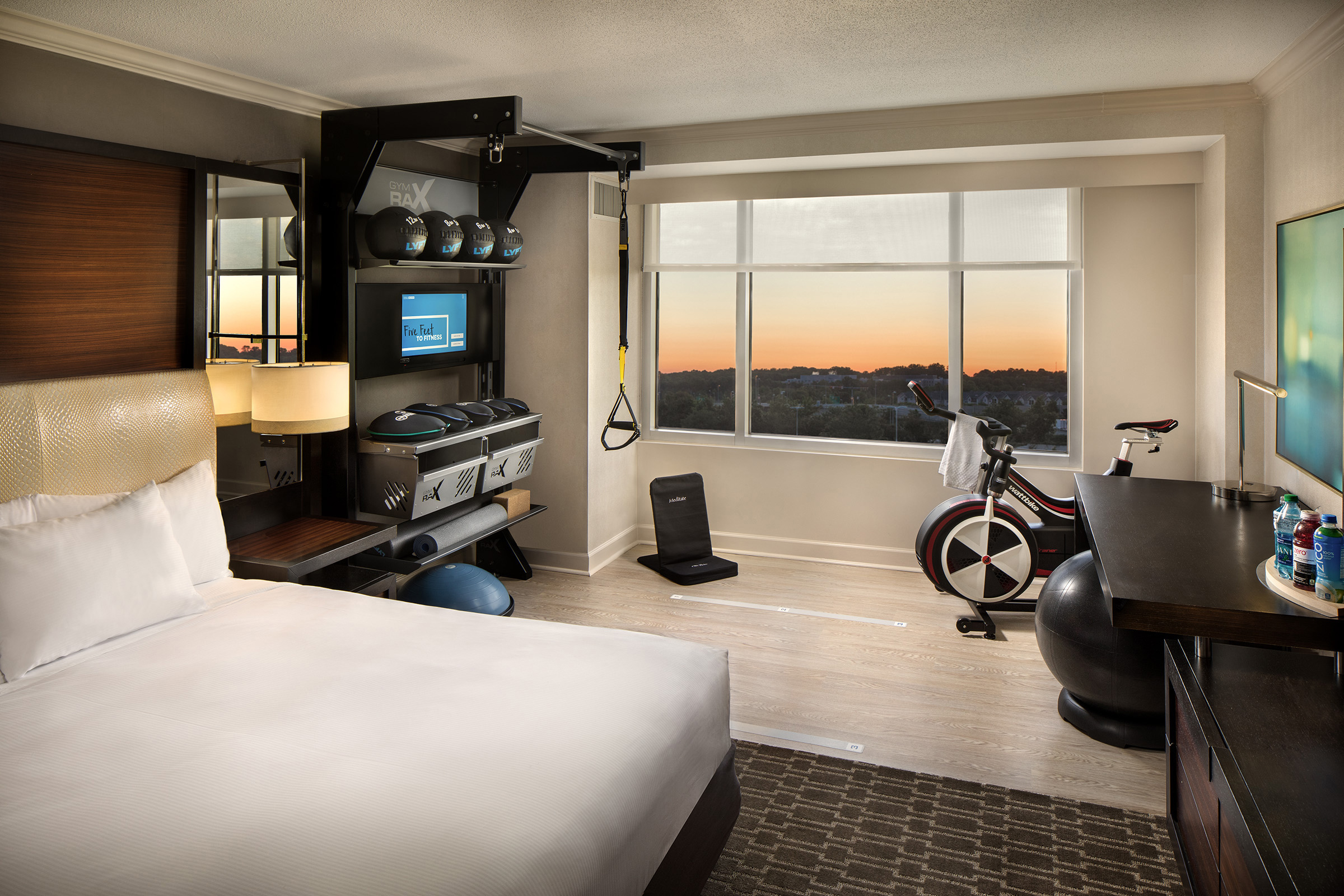 Hilton's Five Feet to Fitness guestroom design includes a fully integrated fitness experience.