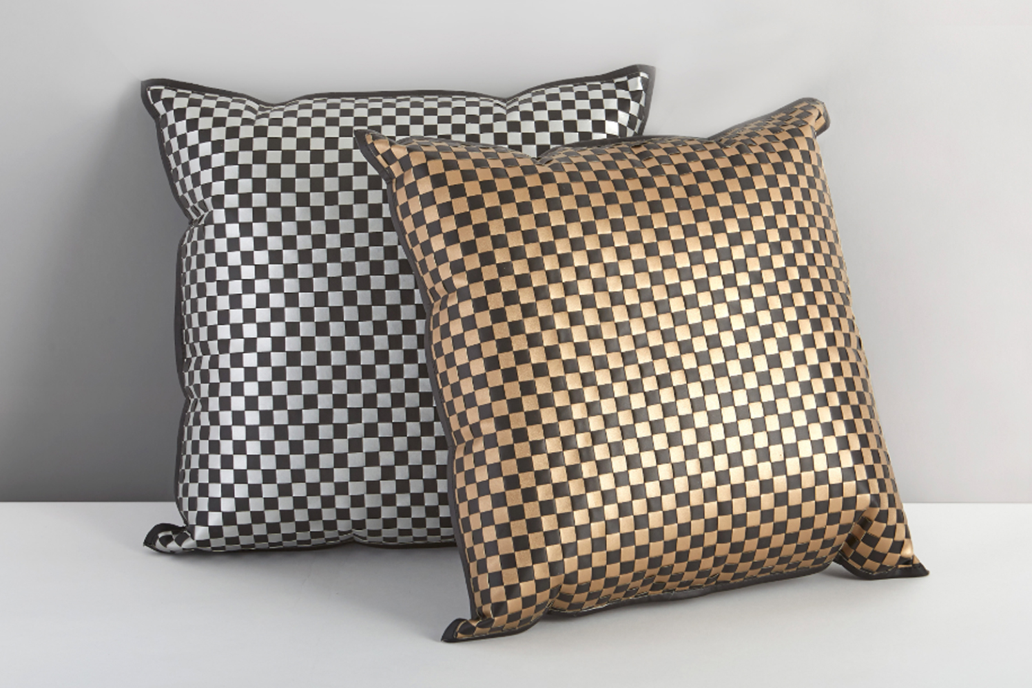 The metallic look of the Slate pillow makes it a standout piece in any guestroom.