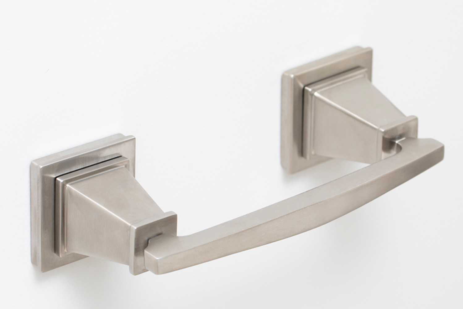 The bathroom accessories range from towel rings to robe hooks, all complementary to the Malvina fixtures' signature geometric profile.