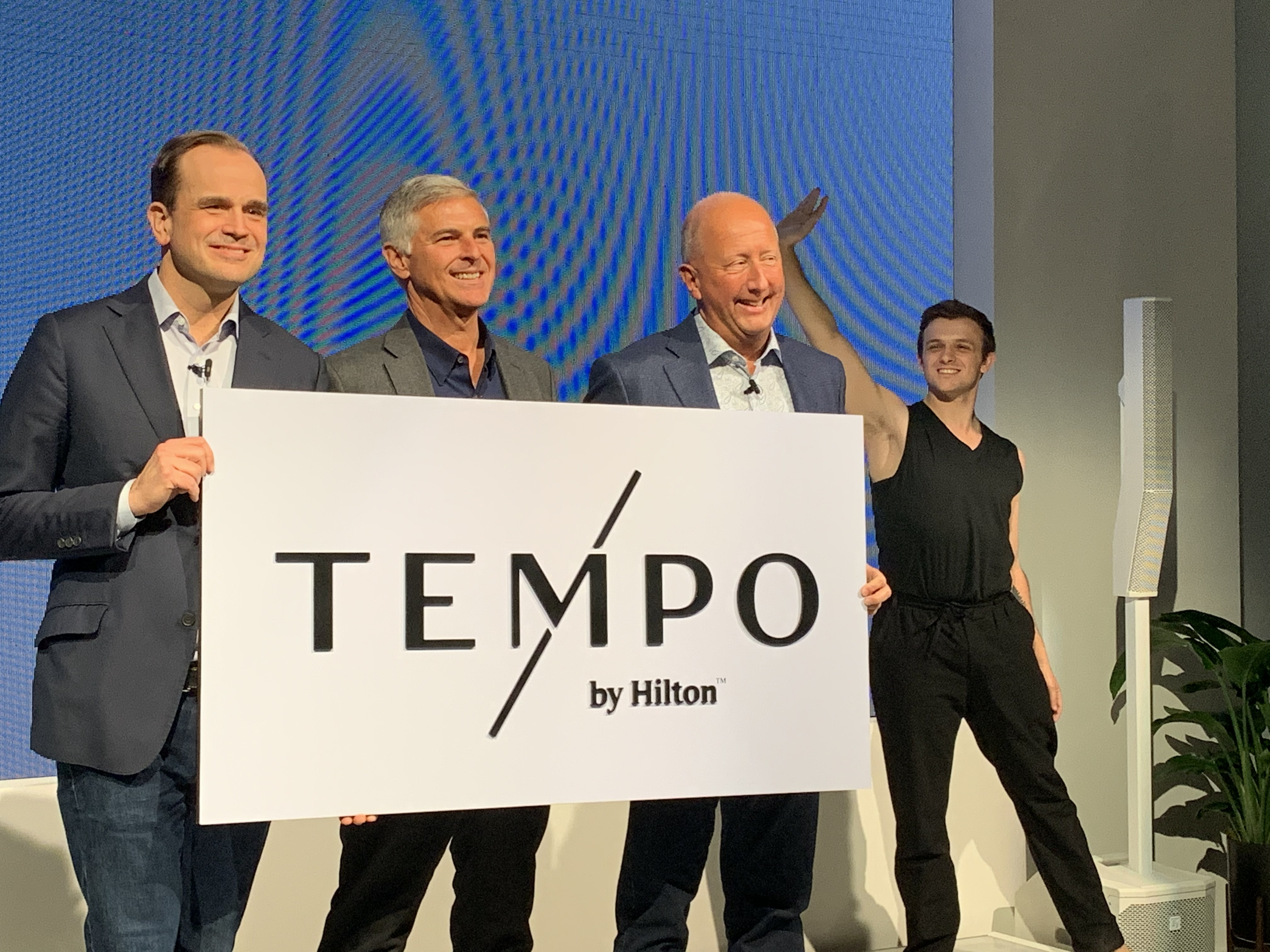 At the Jan. 16 brand launch, Hilton's Chief Customer Officer Jon Witter, President/CEO Chris Nassetta and Global Head/New Brand Development Phil Cordell show off Tempo by Hilton logo. Photo credit: Hotel Management