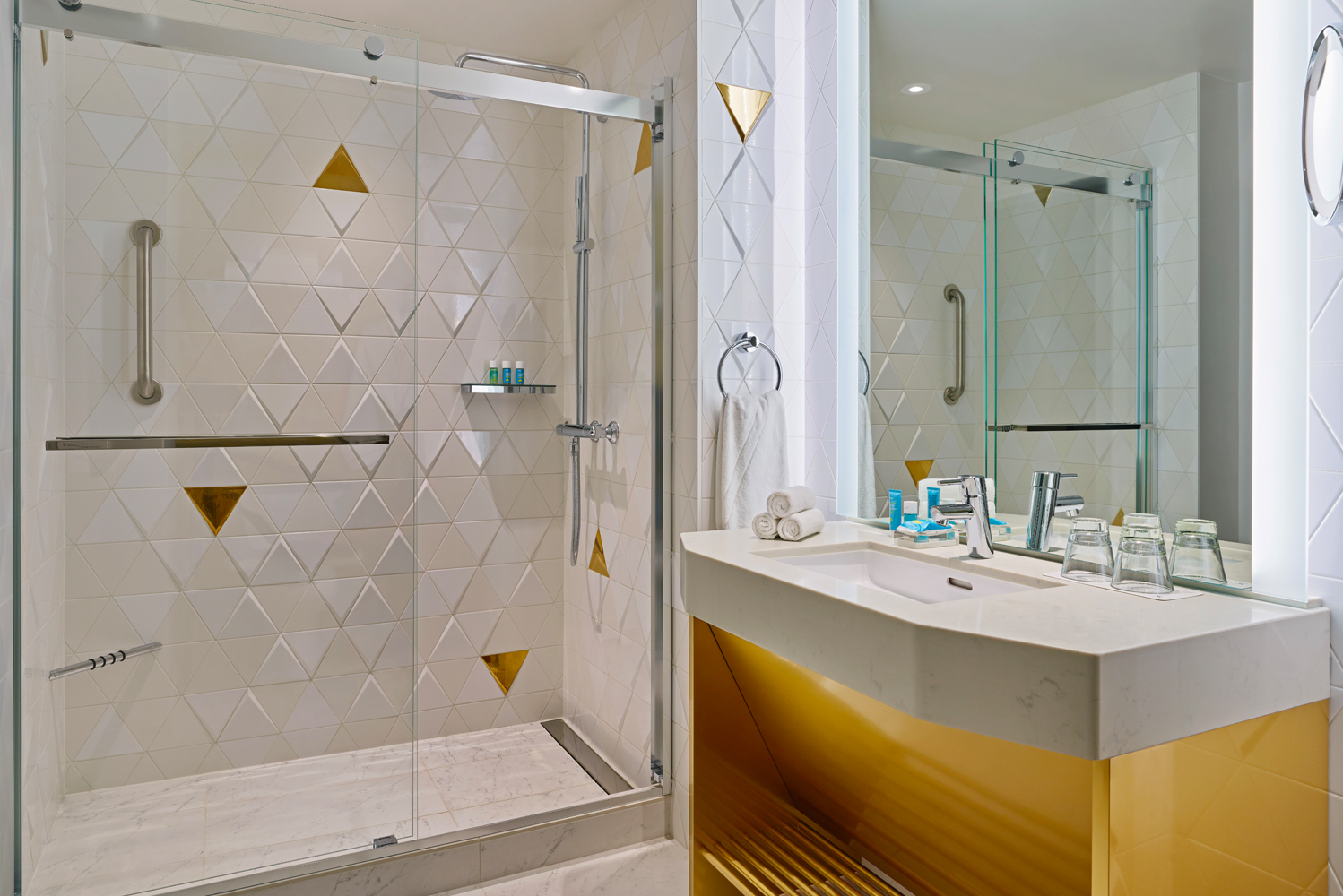 The fog is also represented in the gold-flaked white and gray bathroom tiles, which also depict San Francisco's topography.