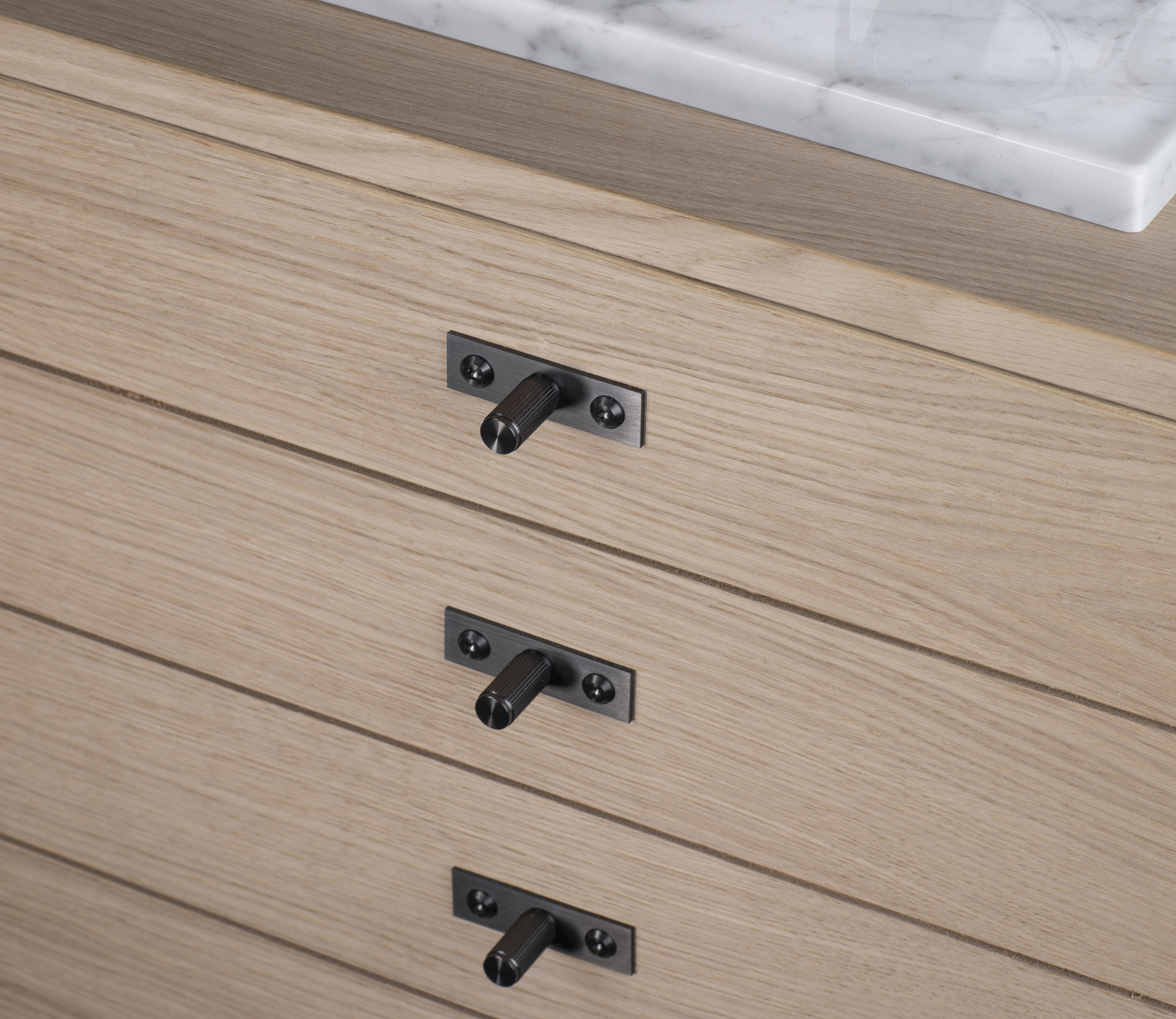 The collection includes a new small-scale design style with a linear knurl pattern.