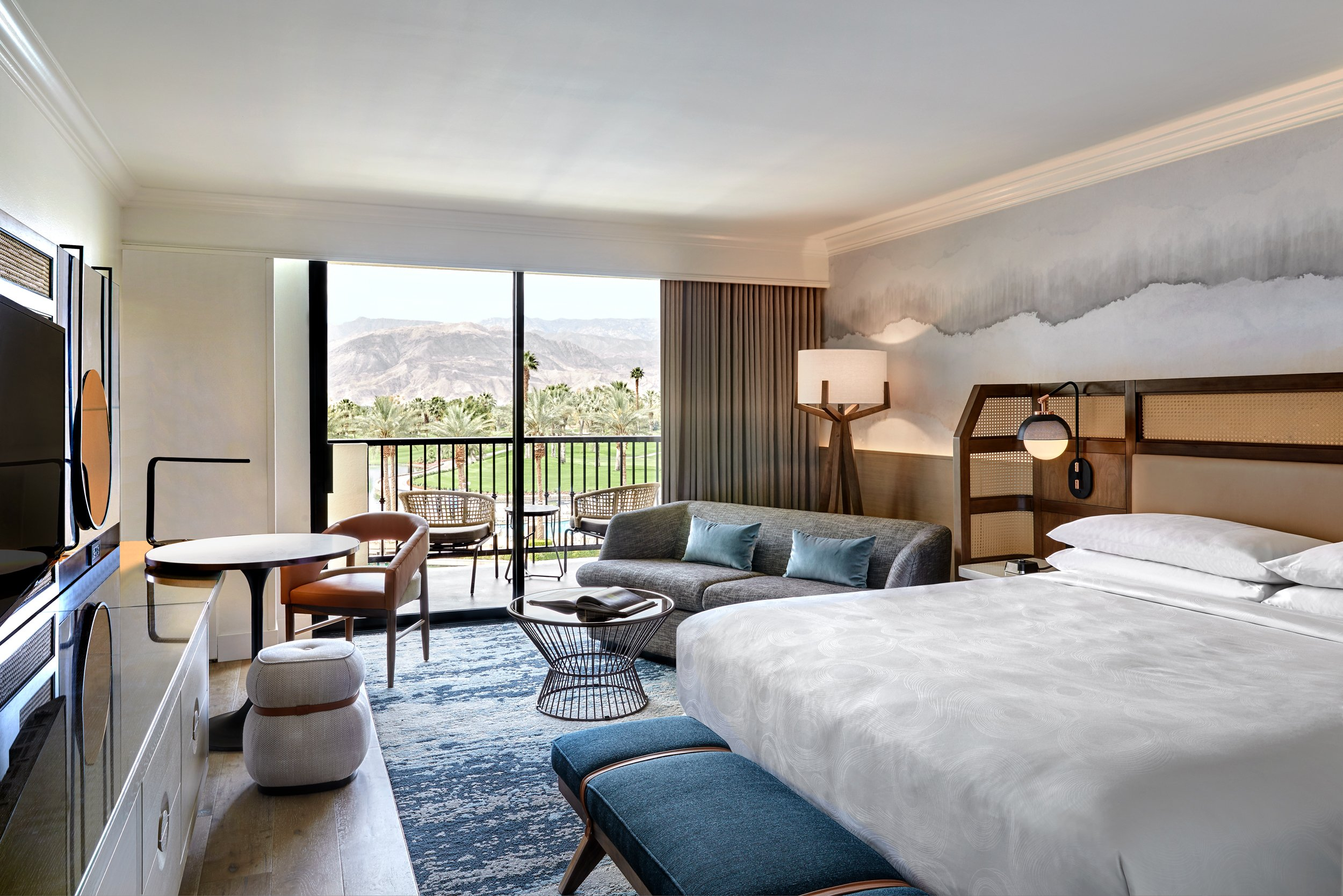 The guestrooms have updated hardwood floors, modern furnishings, bedding, and mountain-inspired silhouette murals.