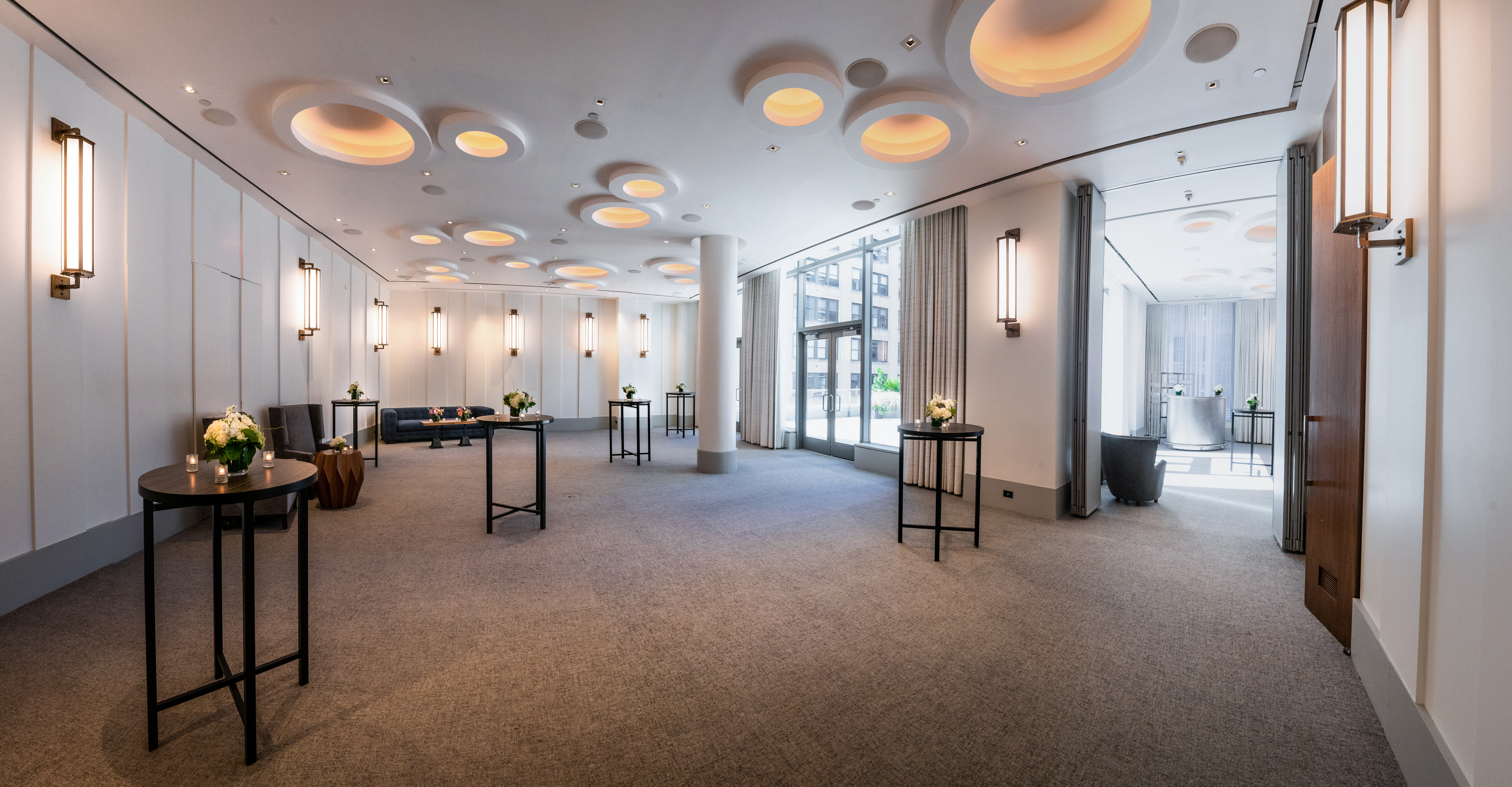 The event spaces use bright colors, custom dyes, new light fixtures, contemporary drapes, reupholstered furniture and hand-dyed carpets.