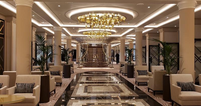 The grand, elegant lower atrium area on Seven Seas Splendor. Photo by Susan J. Young