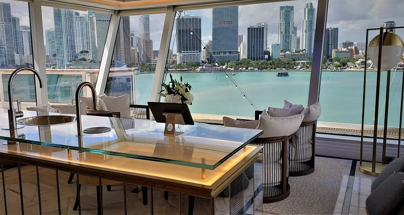 The Regent Suite's interior lounge has seating, a bar and floor-to-ceiling glass for incredible views such as downtown Miami (shown here). Photo by Susan J. Young