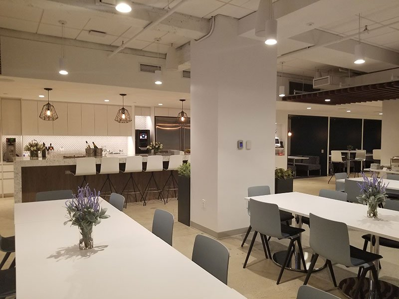 A large kitchen serves as the center of the new space