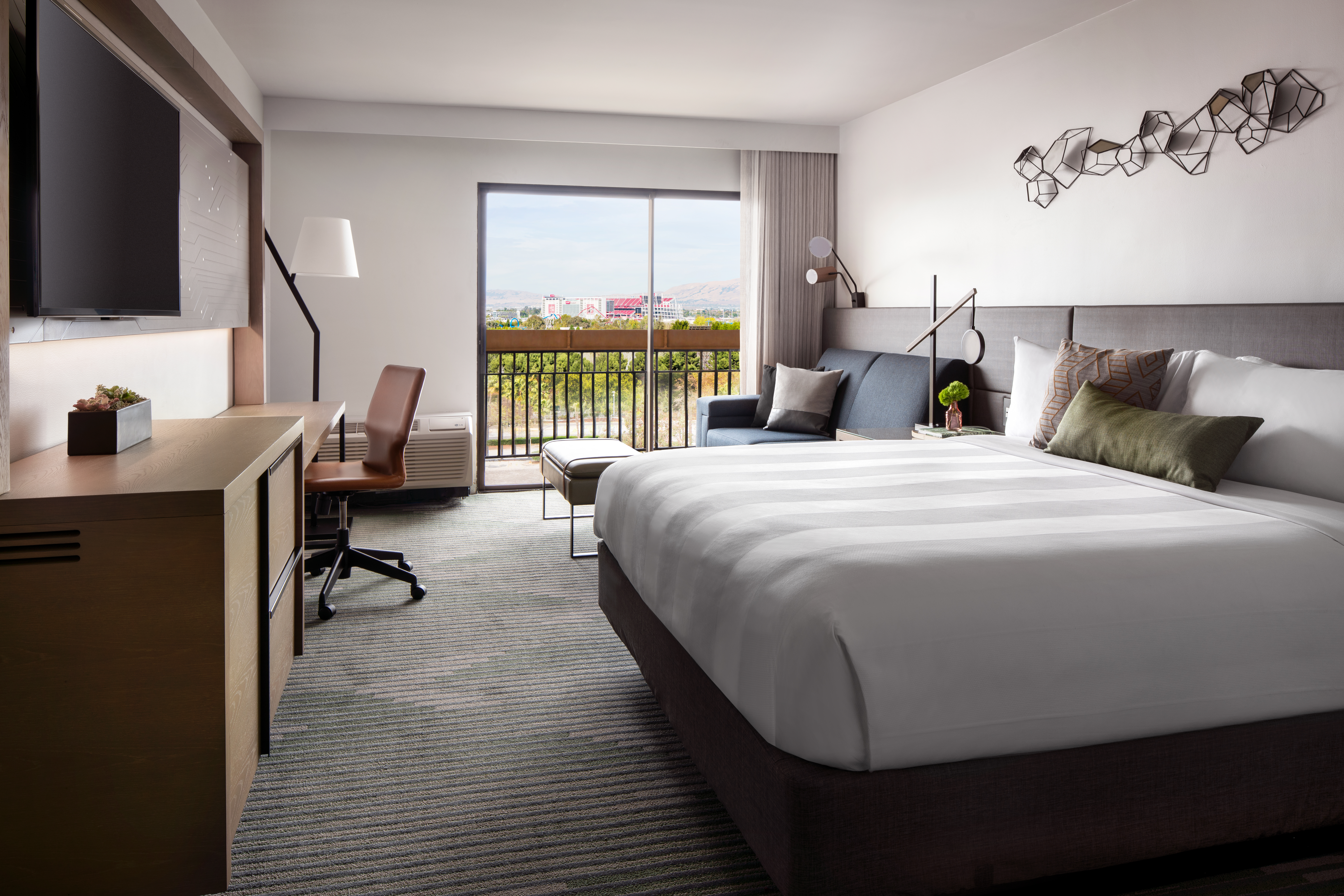 Guestrooms have details like circuit board-styled artwork.