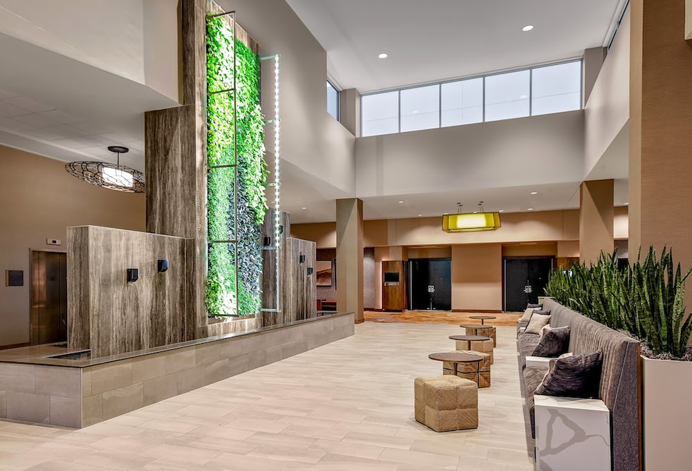 The lobby of the Embassy Suites by Hilton Jonesboro Red Wolf Convention Center is outfitted with nature-inspired artwork.