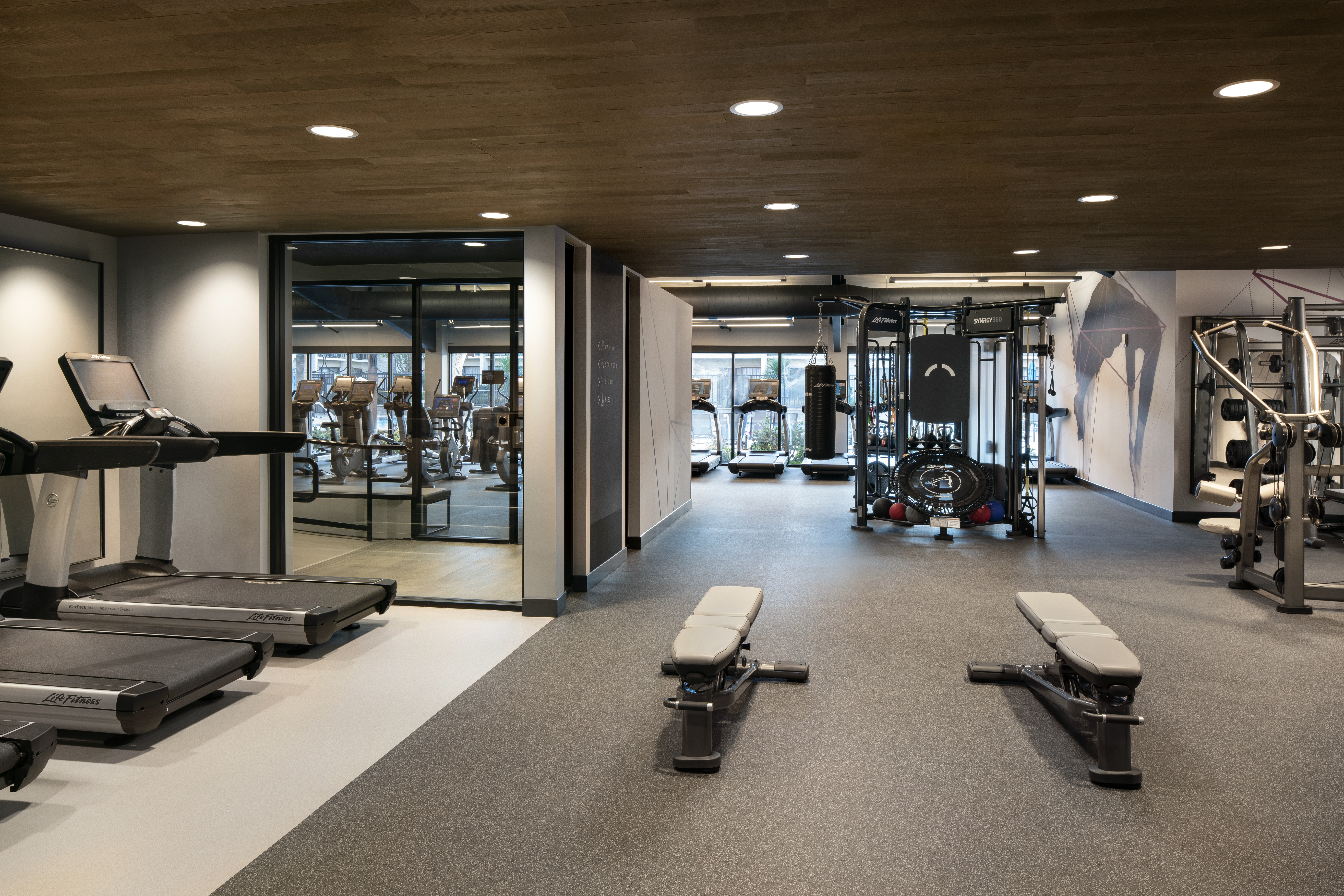 The new fitness center has views of the pool deck.