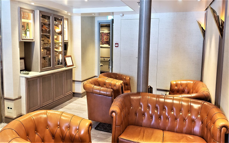 The Connoisseurs Club, the cigar and smoking lounge, relocated to Deck 8. Photo by Susan J. Young
