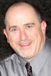 head shot photo of Adam Goslin