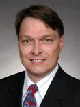 headshot of Devon Herrick