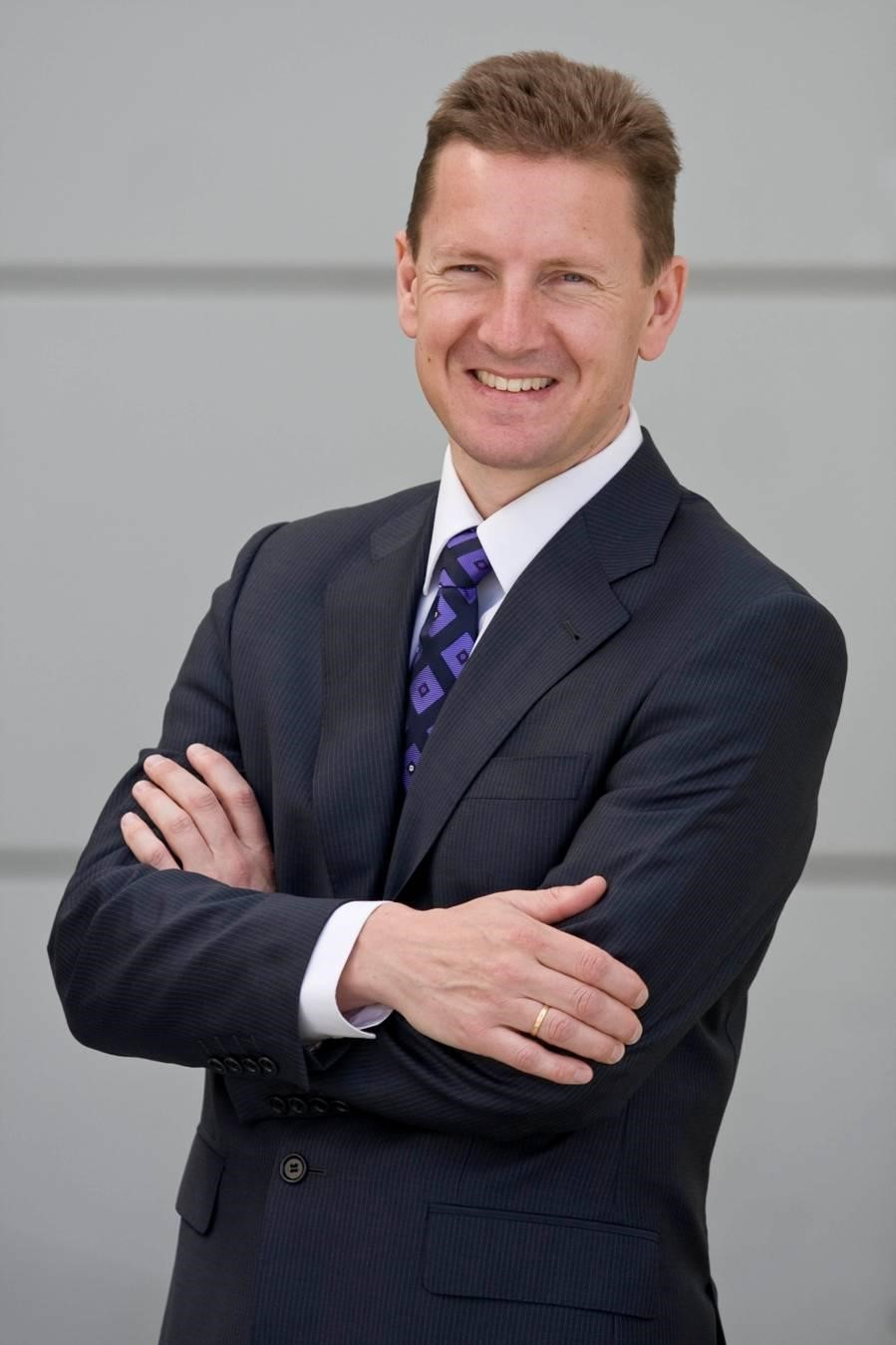 Photo of man in suit