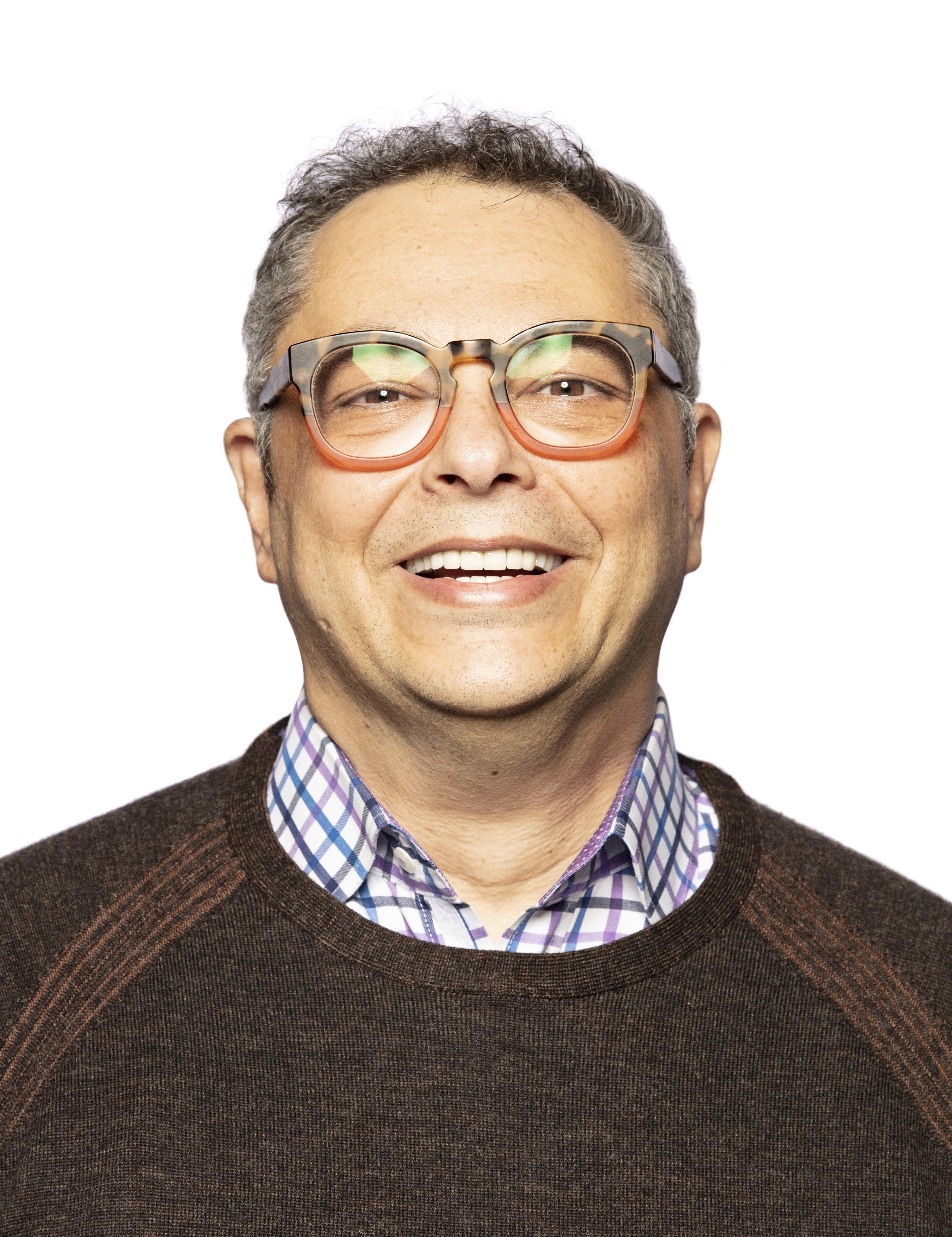 headshot of Taha Kass Hout
