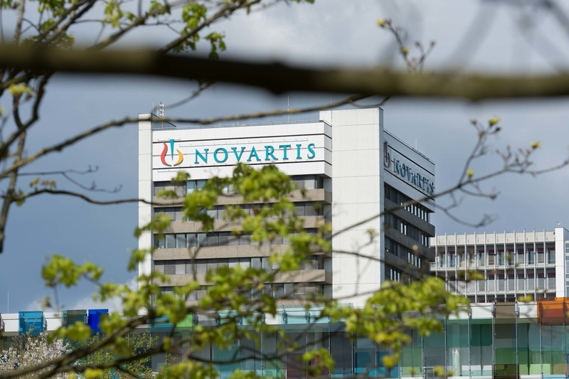 Slashing 186 jobs, Novartis hands off U.S. sales, marketing duties for migraine med Aimovig to Amgen