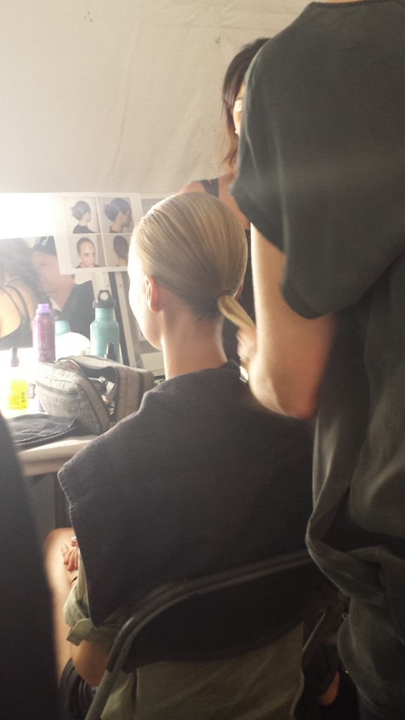 The hair was pulled back into a ponytail before braiding.