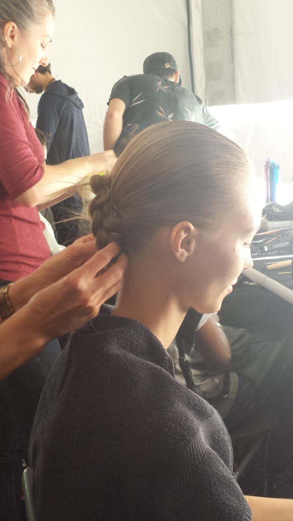 The braid was wrapped into a low bun and secured with bobby pins.