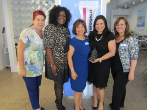 FROM LEFT: Angel Brant, UAO member; Tonya Mull, vice president, UAO; Martha Hoffman, founder and CEO, UAO; Annet King, director of global education, Dermalogica and The International Dermal Institute; Lacey Tirone, head of committees, UAO