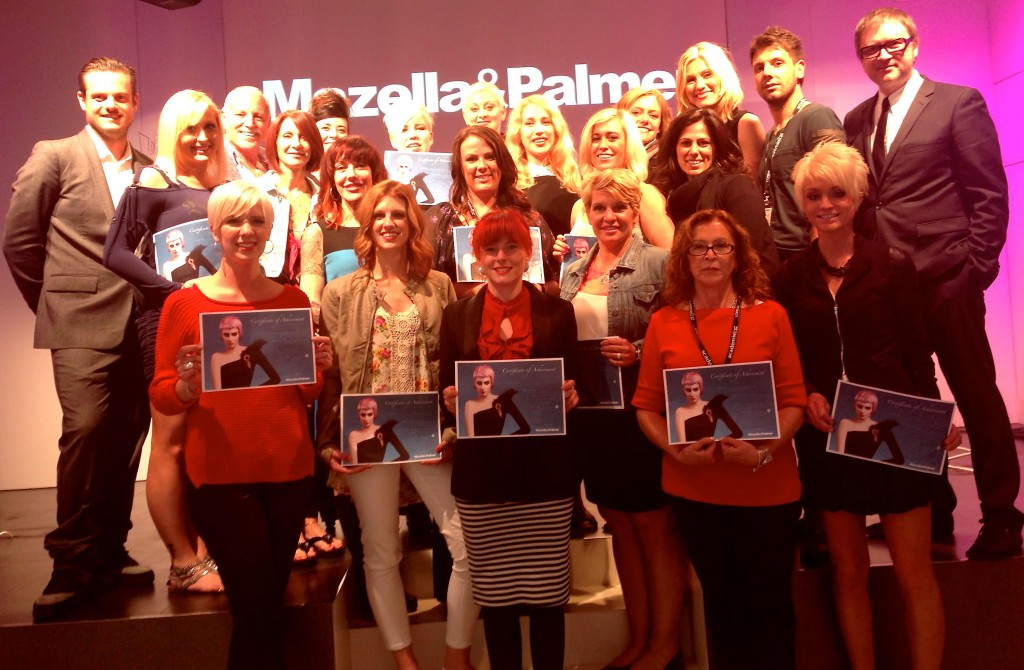 Artists holding diplomas at the graduation of the World Tour with the Mazella & Palmer team.