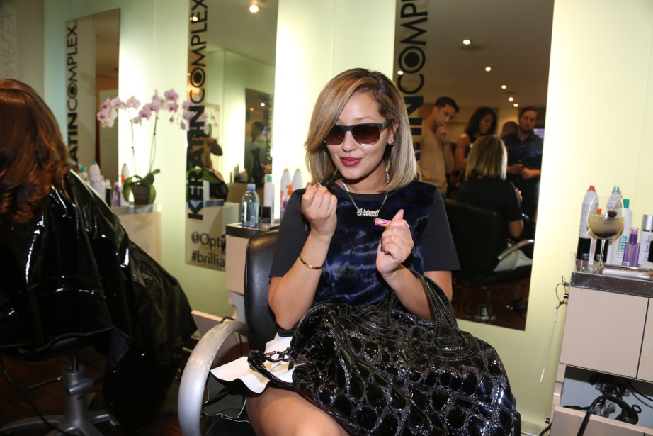 Adrienne Bailon changes up her hairstyle between shows.