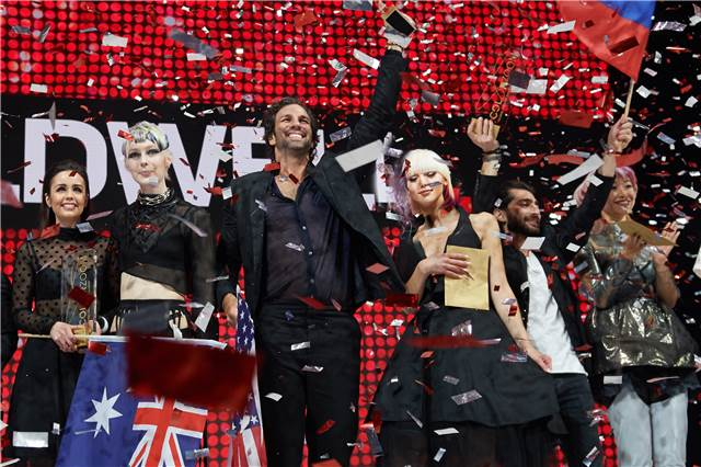 Gold winners Larissa Bresnehan of Australia, Daniel Rudin of the USA and Sargis Airapetian of Russia bask in the adulation of their fellow hairdressers.