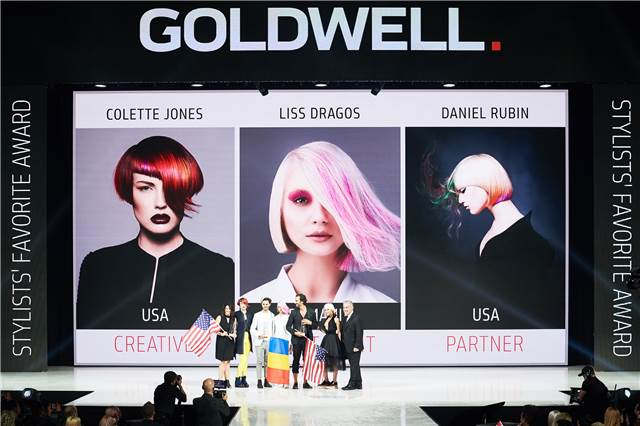Winners of the Stylist's Choice Awards pose in front of their winning images.