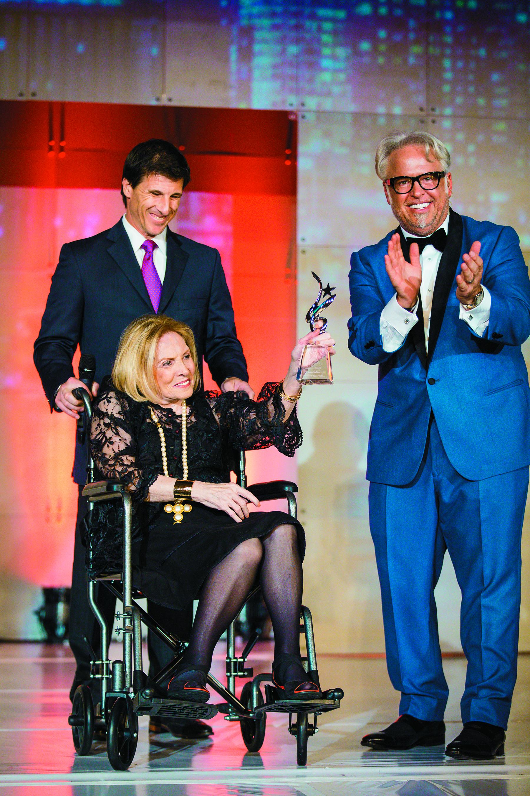 Connie Sullivan accepts her award from Frank Gambuzza.
