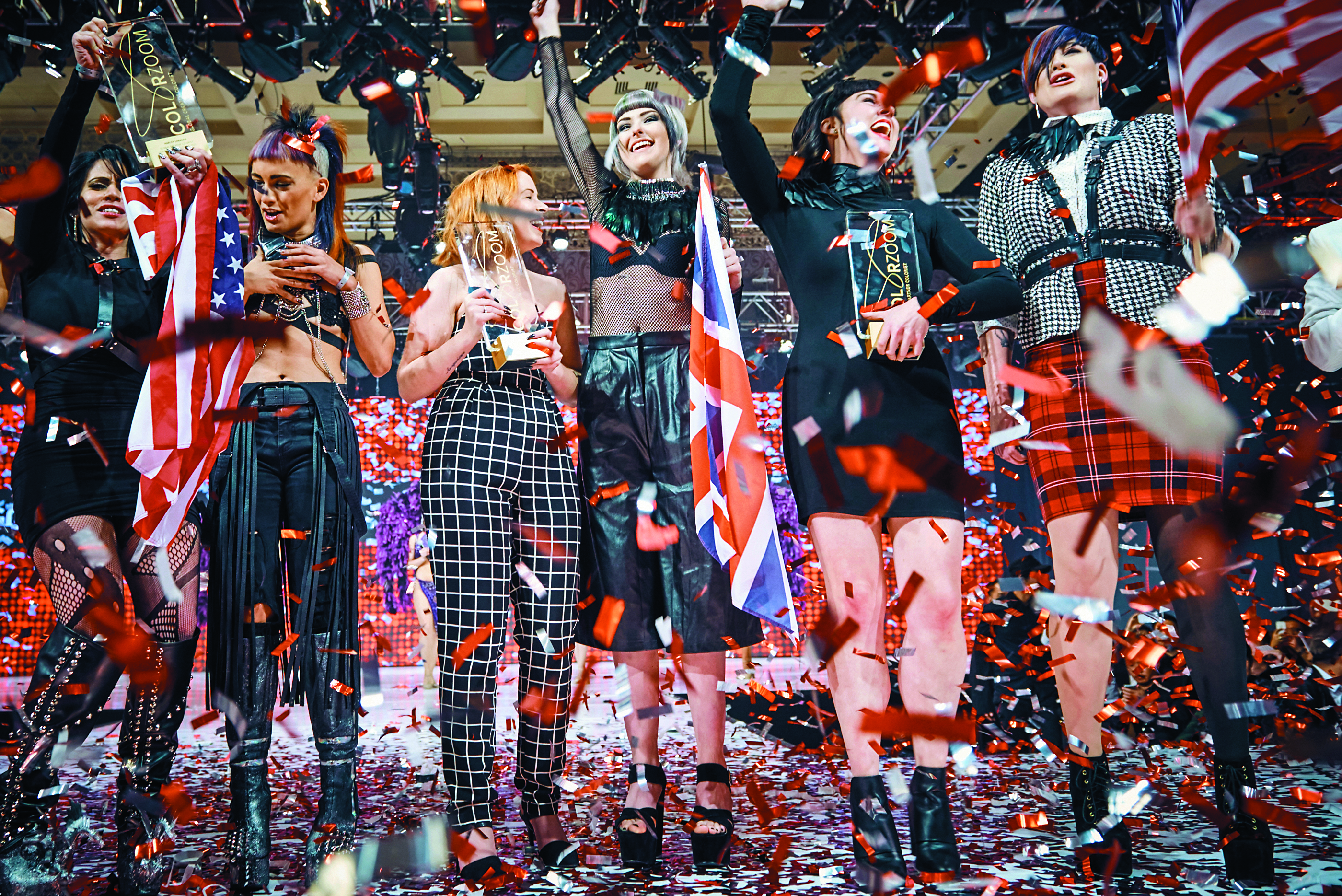 Gold medal winners Harley Lobasso ( U.S., Creative Colorist). Natalie Cara Jones (UK, New Talent) and Corinne Brown (U.S., Partner) are showered with confetti.