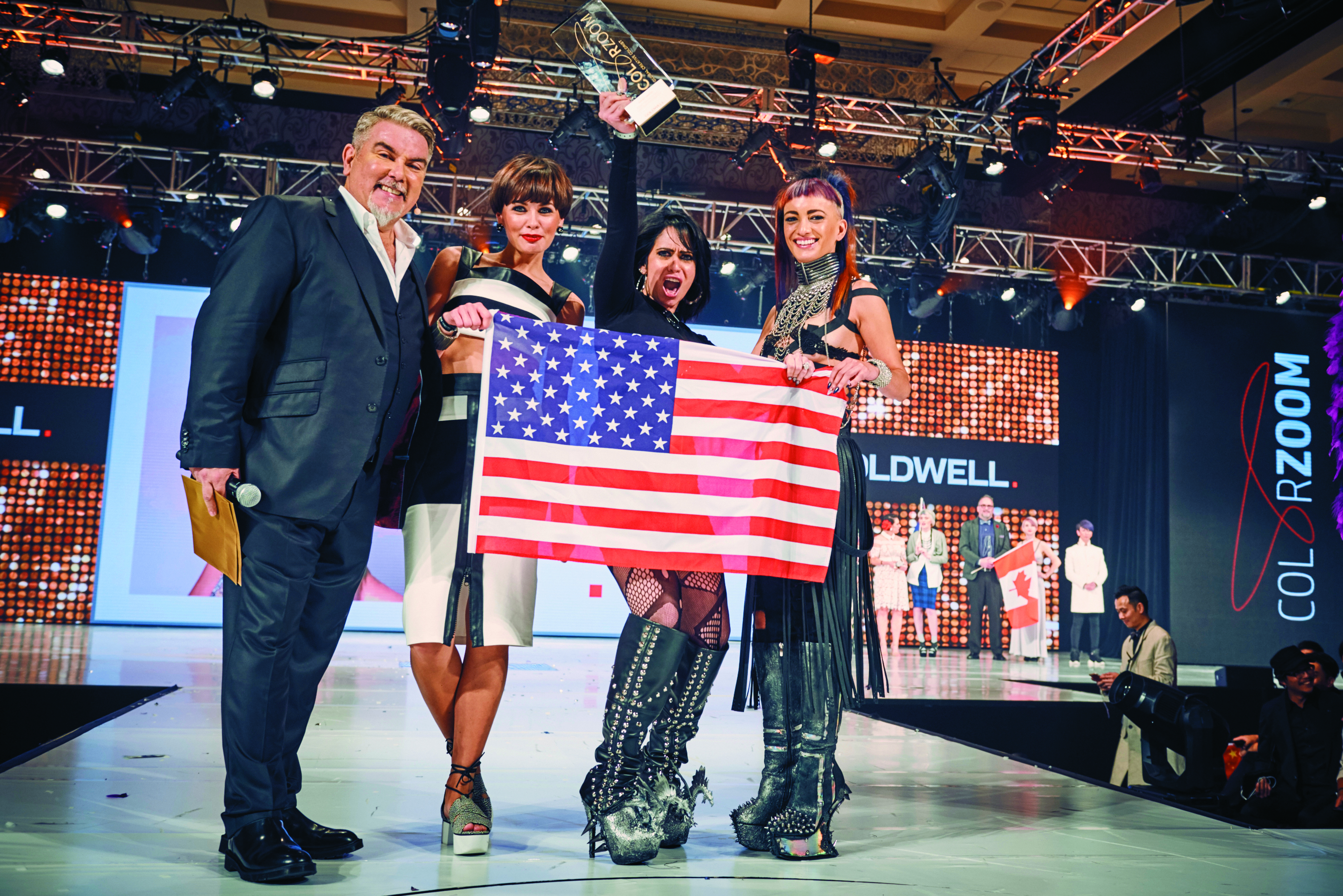 John Moroney, global VP of education, with an exuberant Harley Lobasso hoisting their trophy.