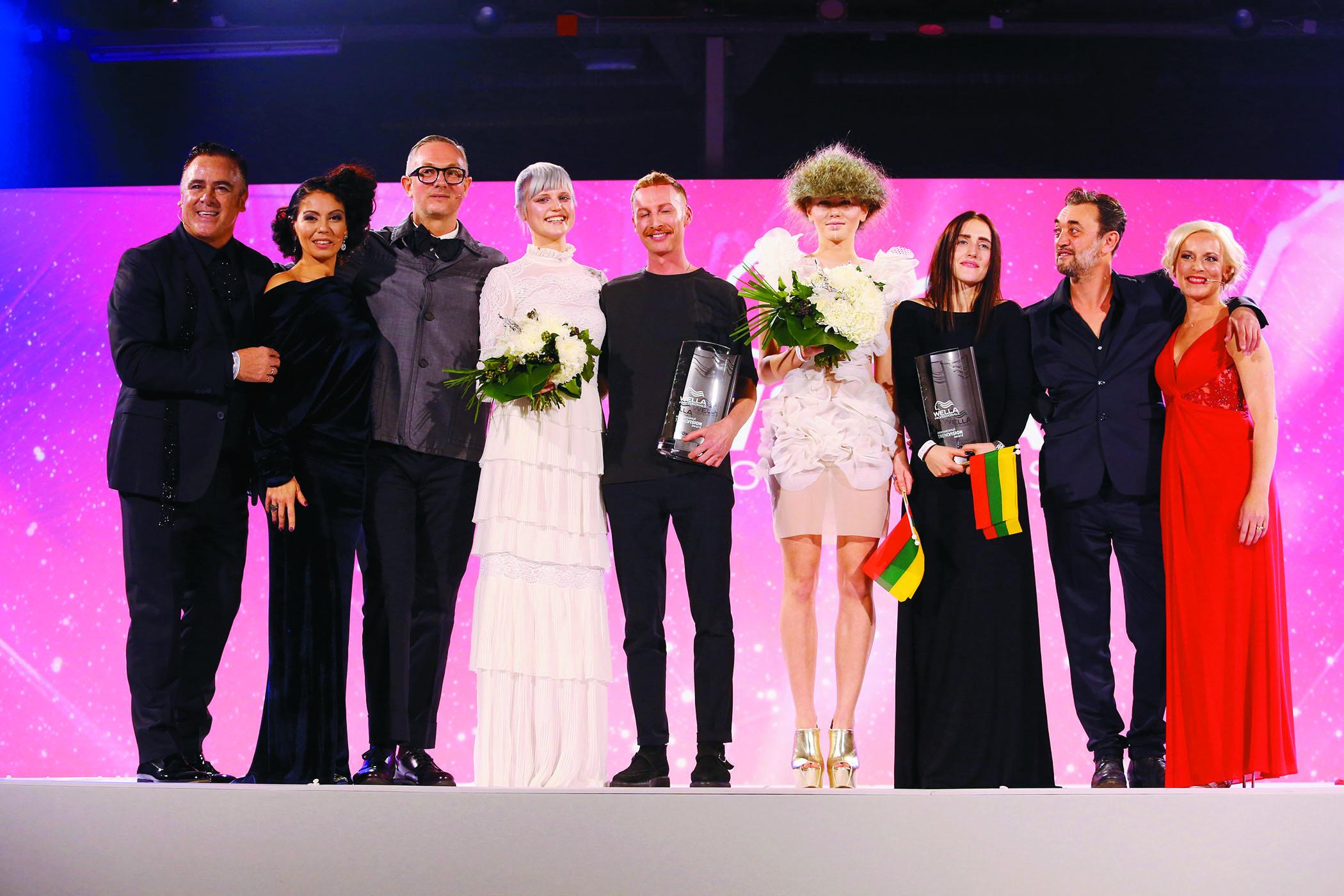 Eugene Souleiman joins Platinum winners Craig Clark and Anastasia Krupovich onstage.