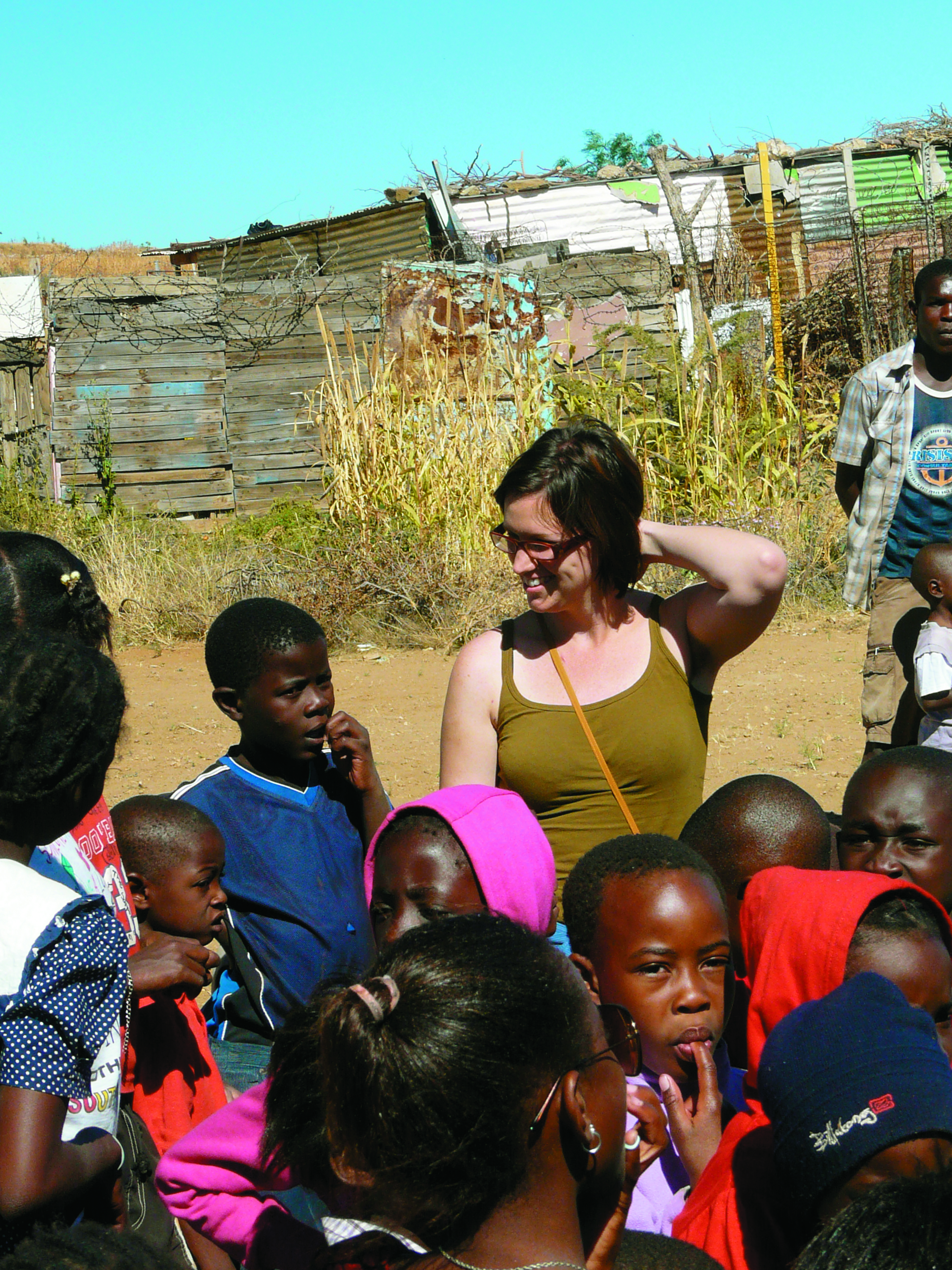 Erin Munsch with a group of children at a Kids-Soup Kitchen outreach event in Katutura, a poor district of Windhoek.