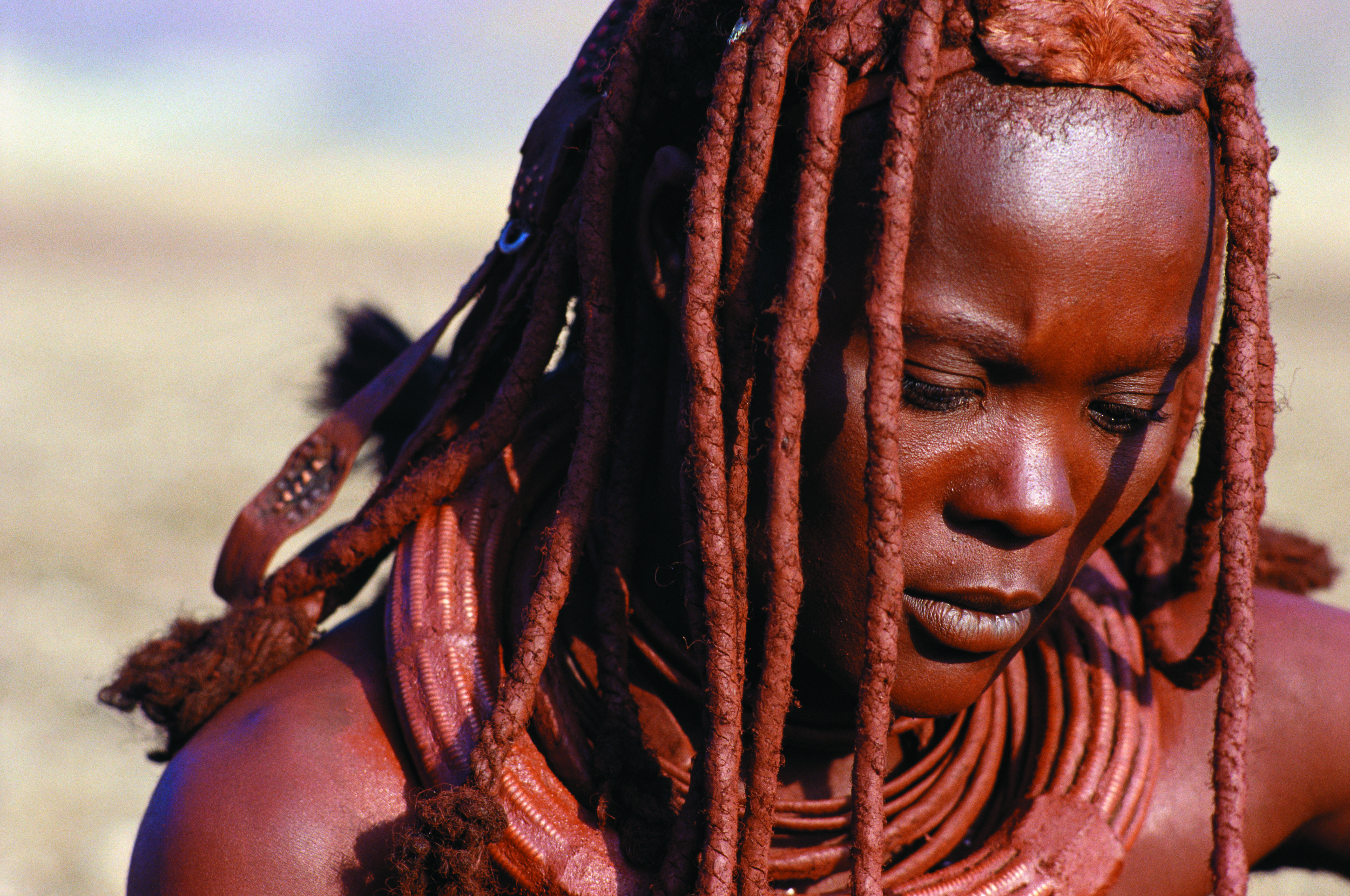 A Himba woman in Northern Namibia, where they use a combination of butter, fat and red ochre to get their braids this shade of copper.