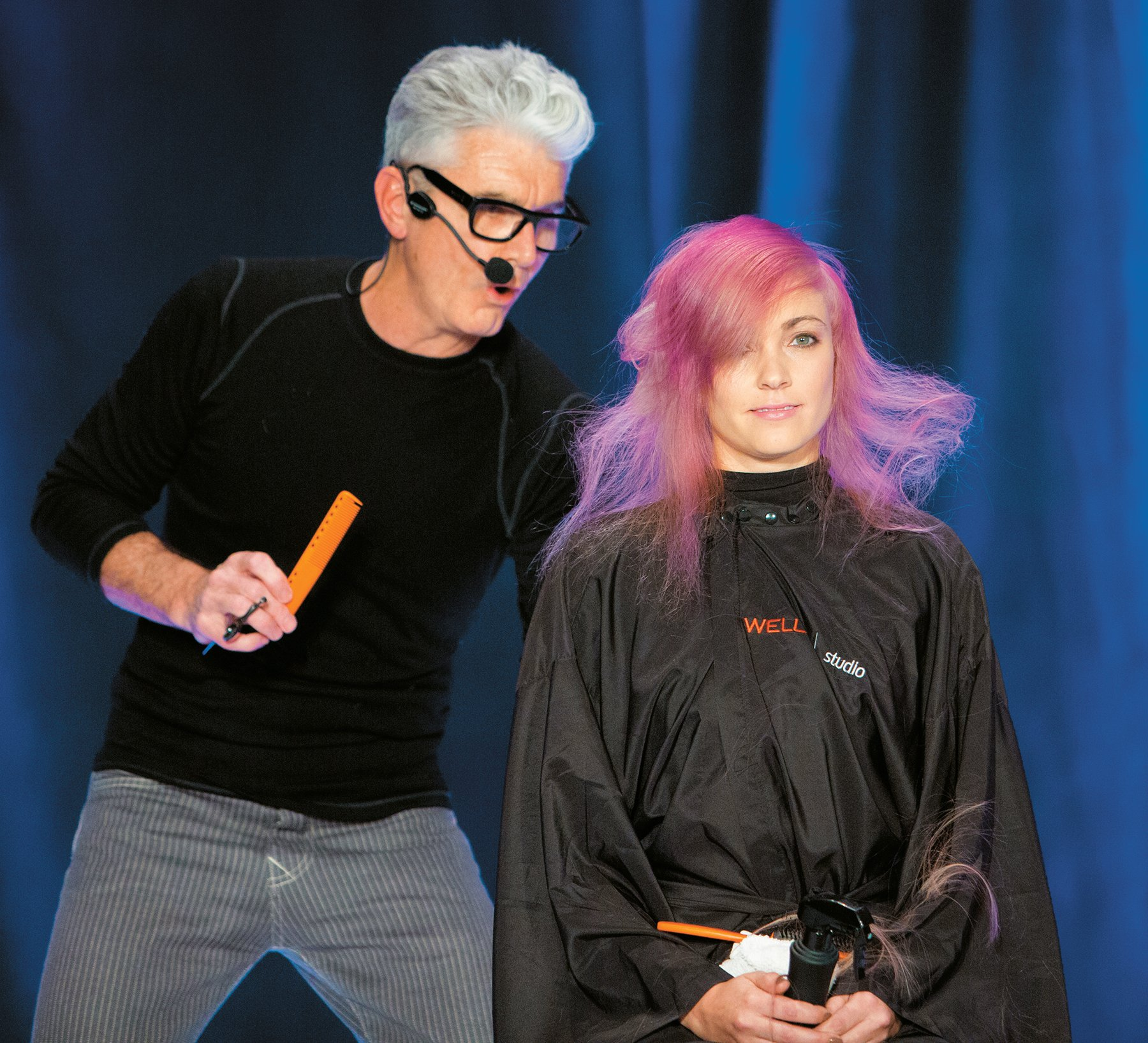 Stephen Moody gives his model finishing touches on stage at the Hairbrained Teach In.