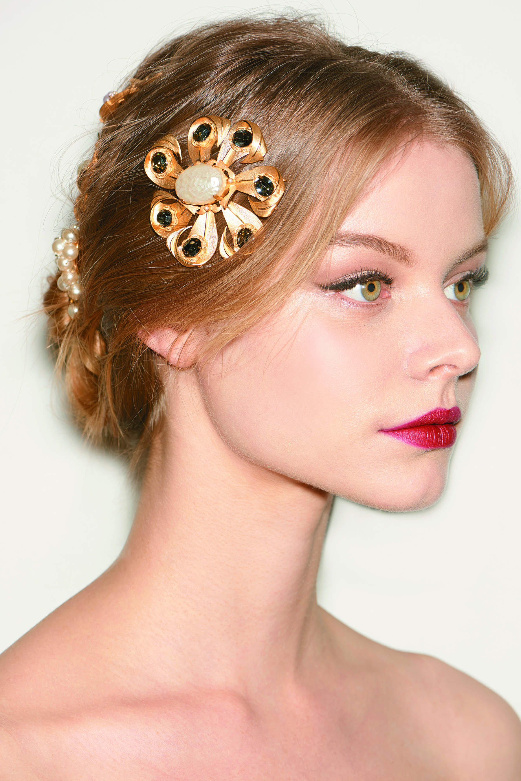 Ornate, jeweled accessories embellished a soft hairstyle at Dolce & Gabbana.