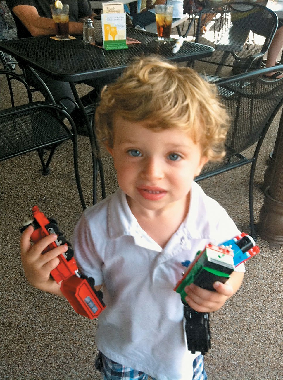 My grandson Levi with his beloved Thomas trains.