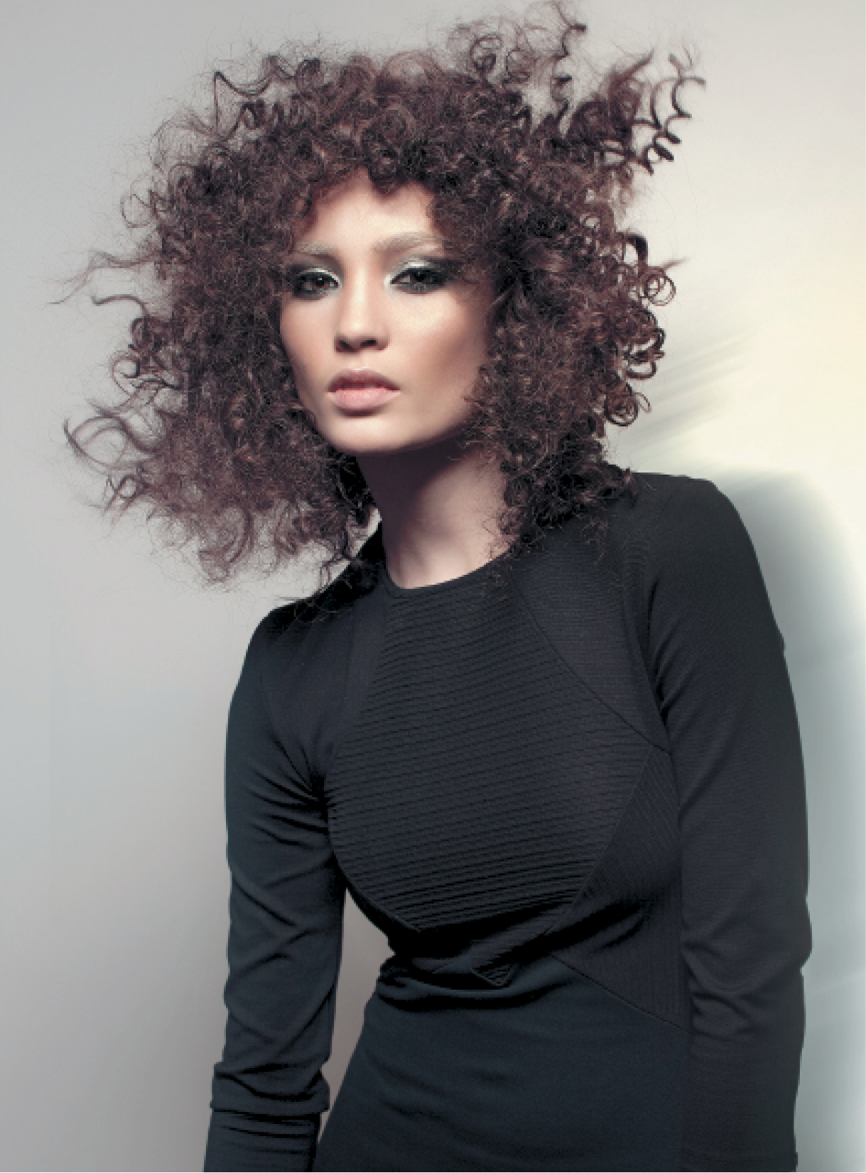To create curls and waves with movement, Buccio separated the ringlets, avoiding brushing them out, and compacted them using Osis Freeze hairspray. Once hair set, he released and separated curls again and applied Osis Glamour Queen for added moveable volume.
