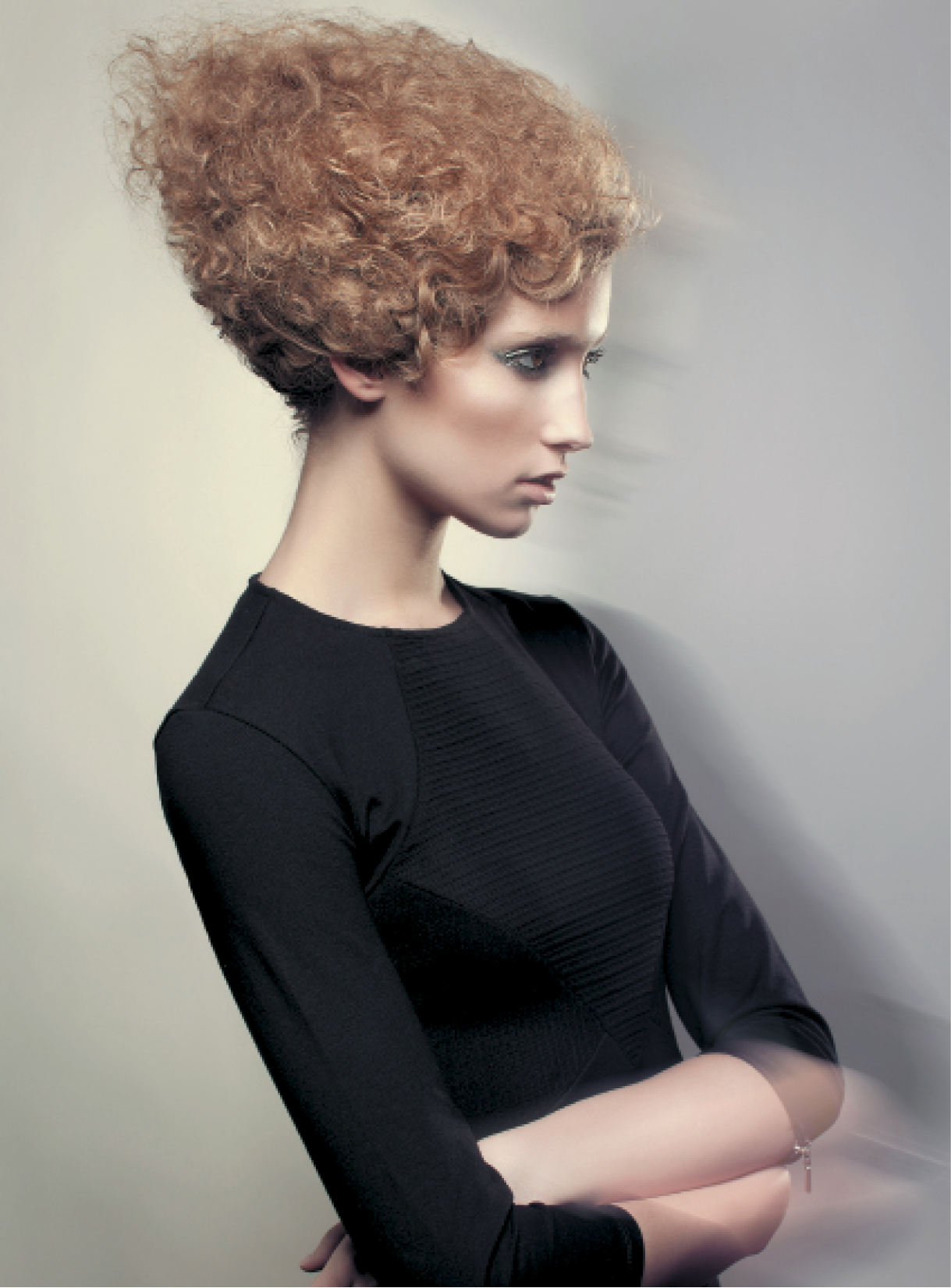 To achieve this look, Jorge Buccio separated every wave and curl, and brushed them out to create extreme volume and texture, similar to an Afro. After achieving body and volume, he compacted the hair with his hands using Schwarzkopf Professional Osis Freeze to resemble wool felt. He applied Osis Session hairspray to finish the look.