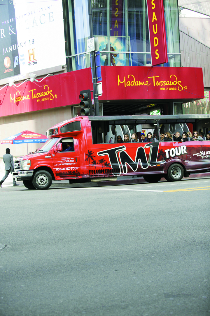 The TMZ tour bus makes its way down Hollywood Boulevard.