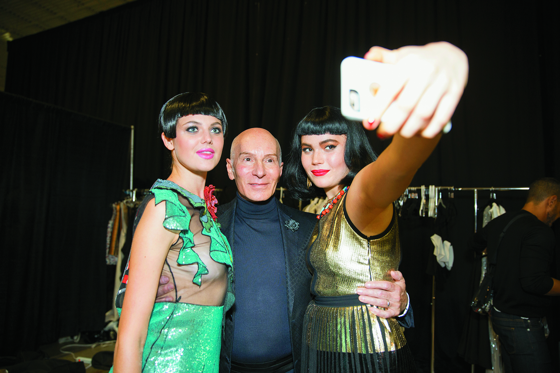 Models taking a selfie with Garren backstage.
