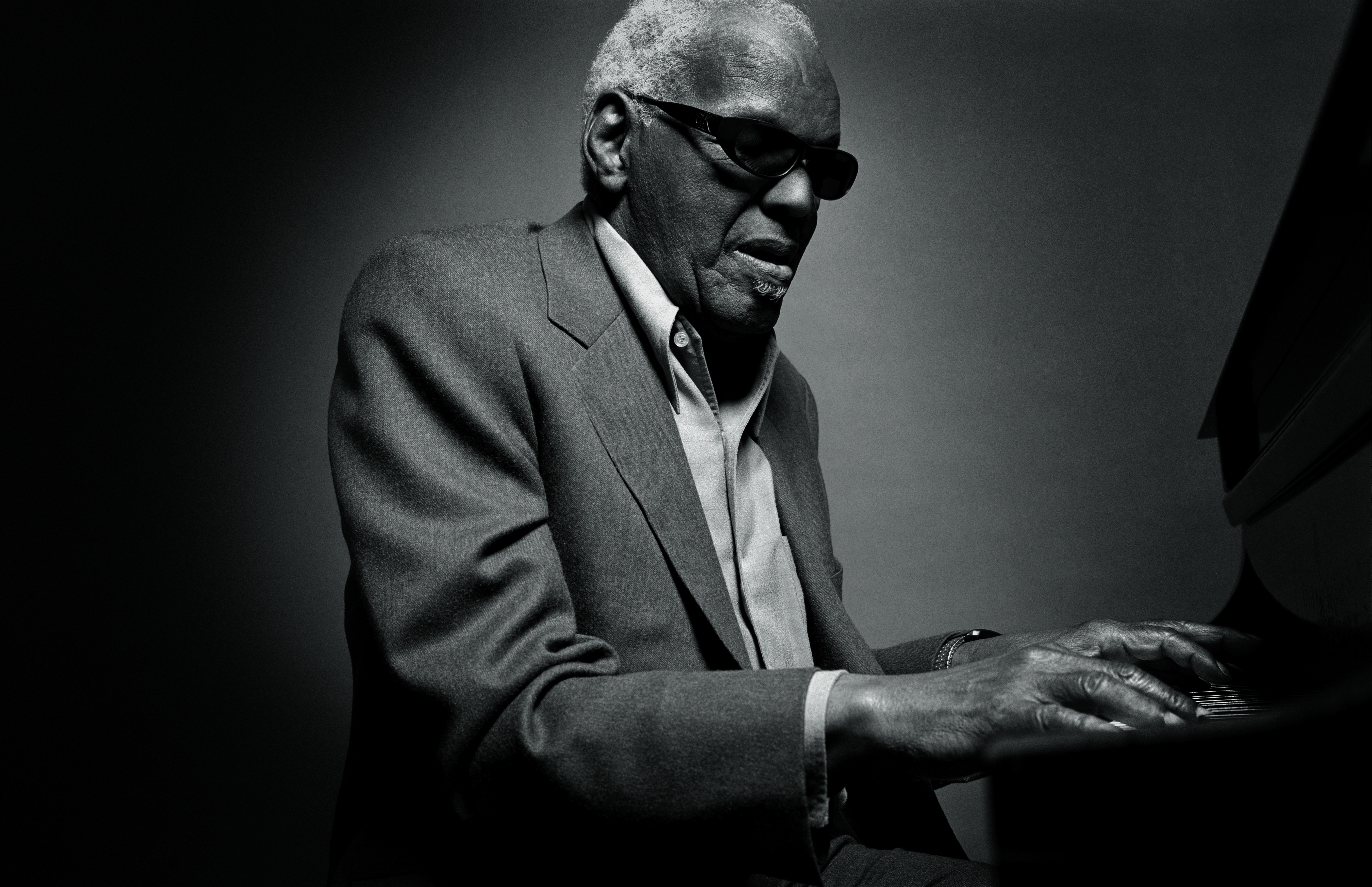 "Raccuglia photographed Ray Charles as the music legend was singing and playing the piano, a moment that will go down in history for him. ""I could barely press the shutter of the camera,"" he says. ""I was more interested in just being in the experience, being in the present, than I was trying to create a picture."""