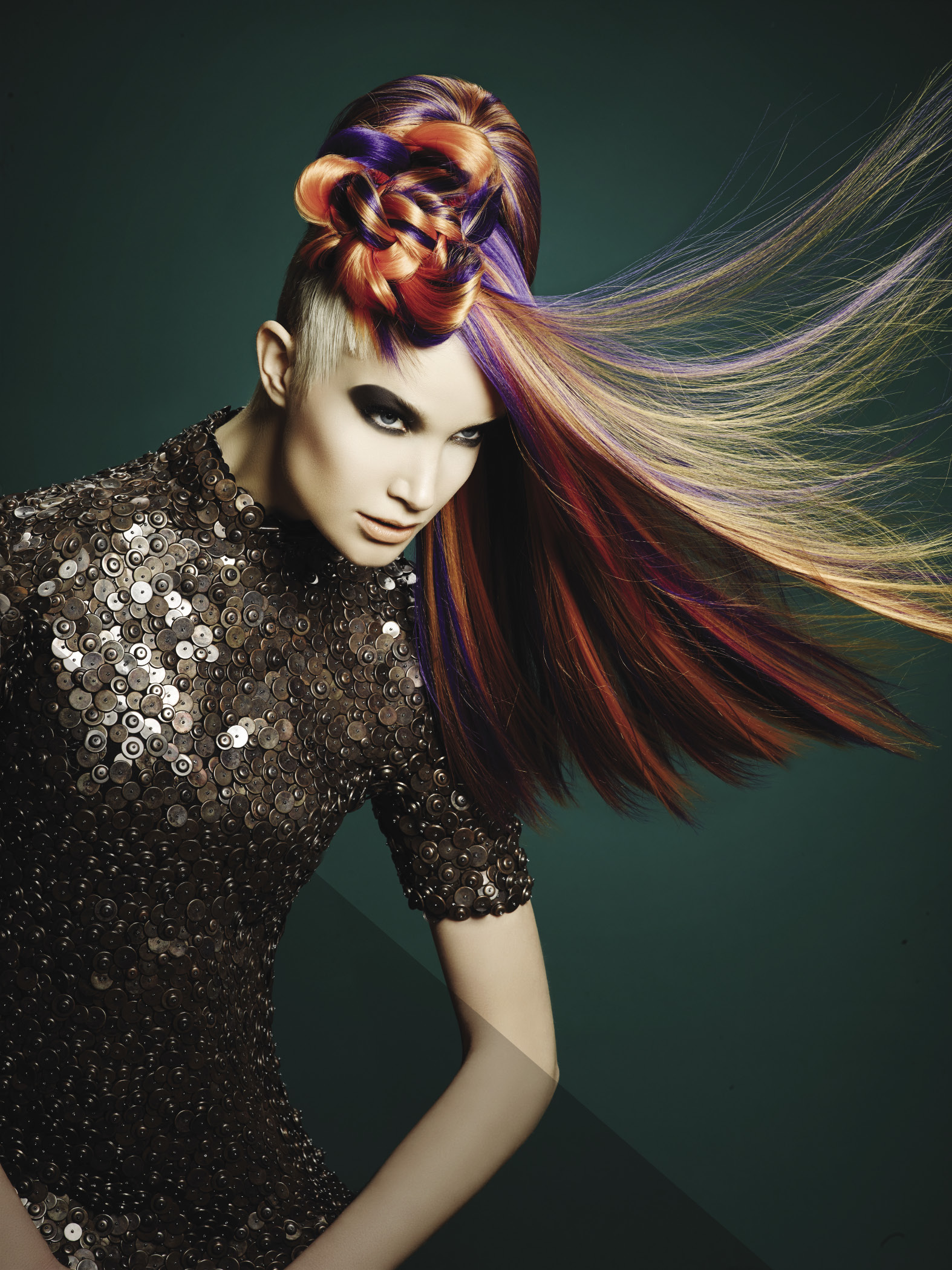 Long, luscious locks in tropical colors flow from a cropped, anti-head shape.