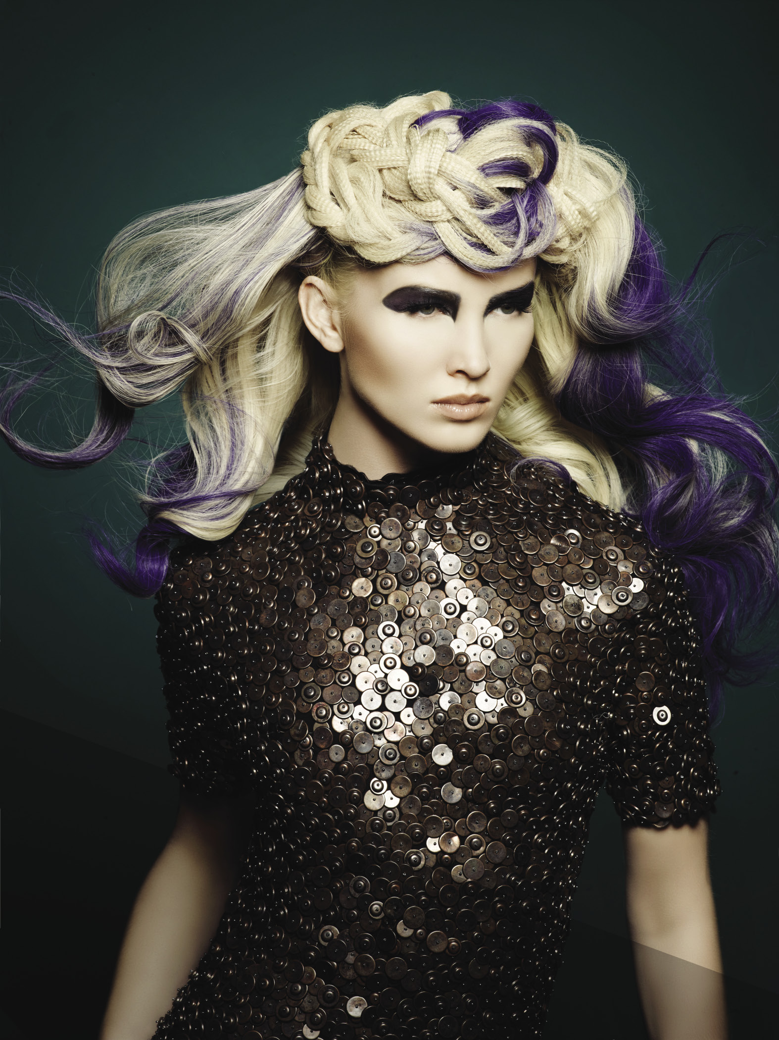 Embossed hair with a braided fusion of pastel color is right on trend.