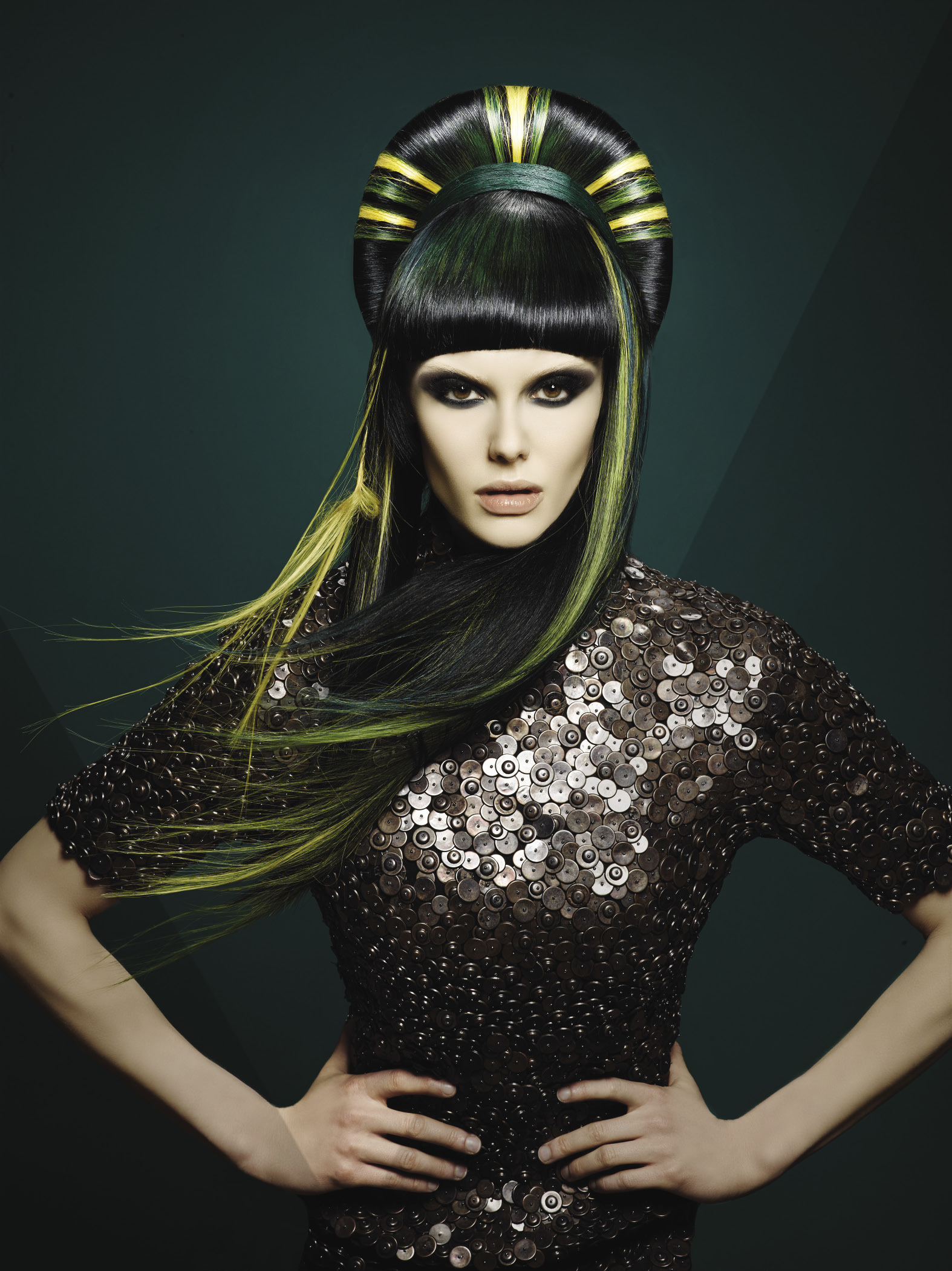 Perfectly crafted bangs are the focus, while strong green and yellow locks stream from a headband made entirely from hair.