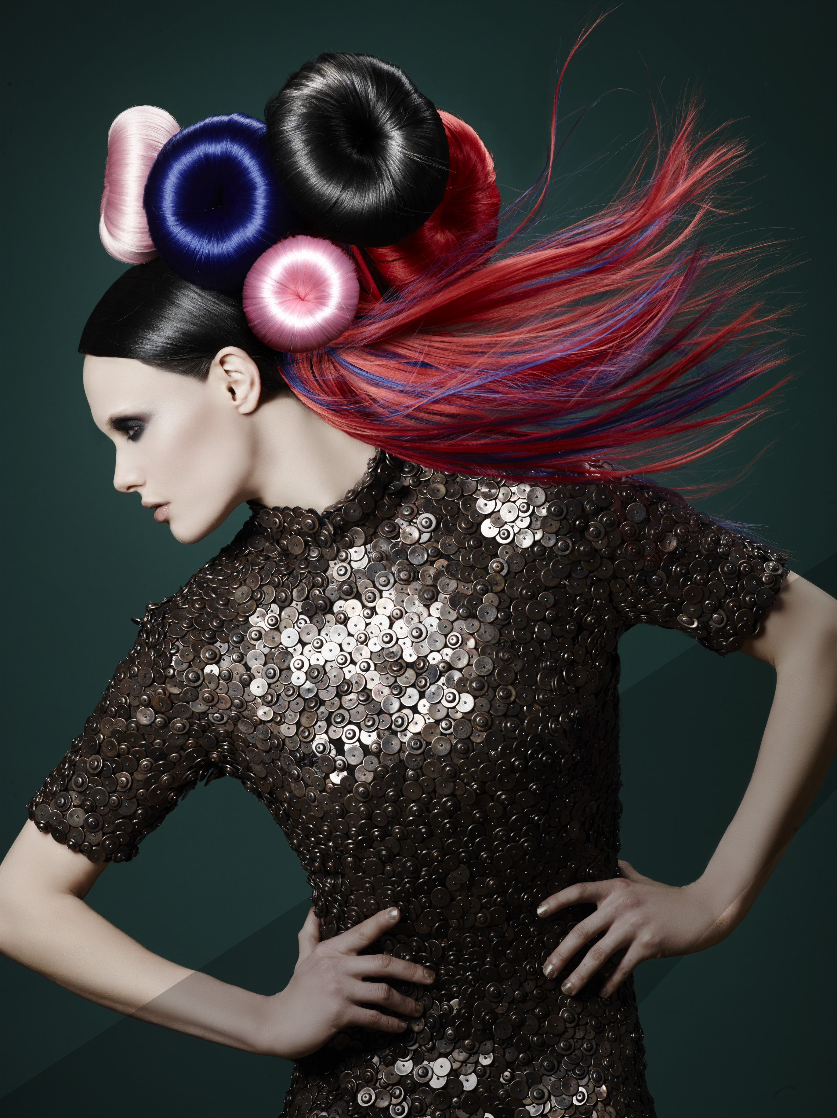 Opposites attract with pads wrapped in slightly metallic-looking shades of pink, blue, black and red hair set in relief against almost stick-straight crimson extensions shot through with royal blue.