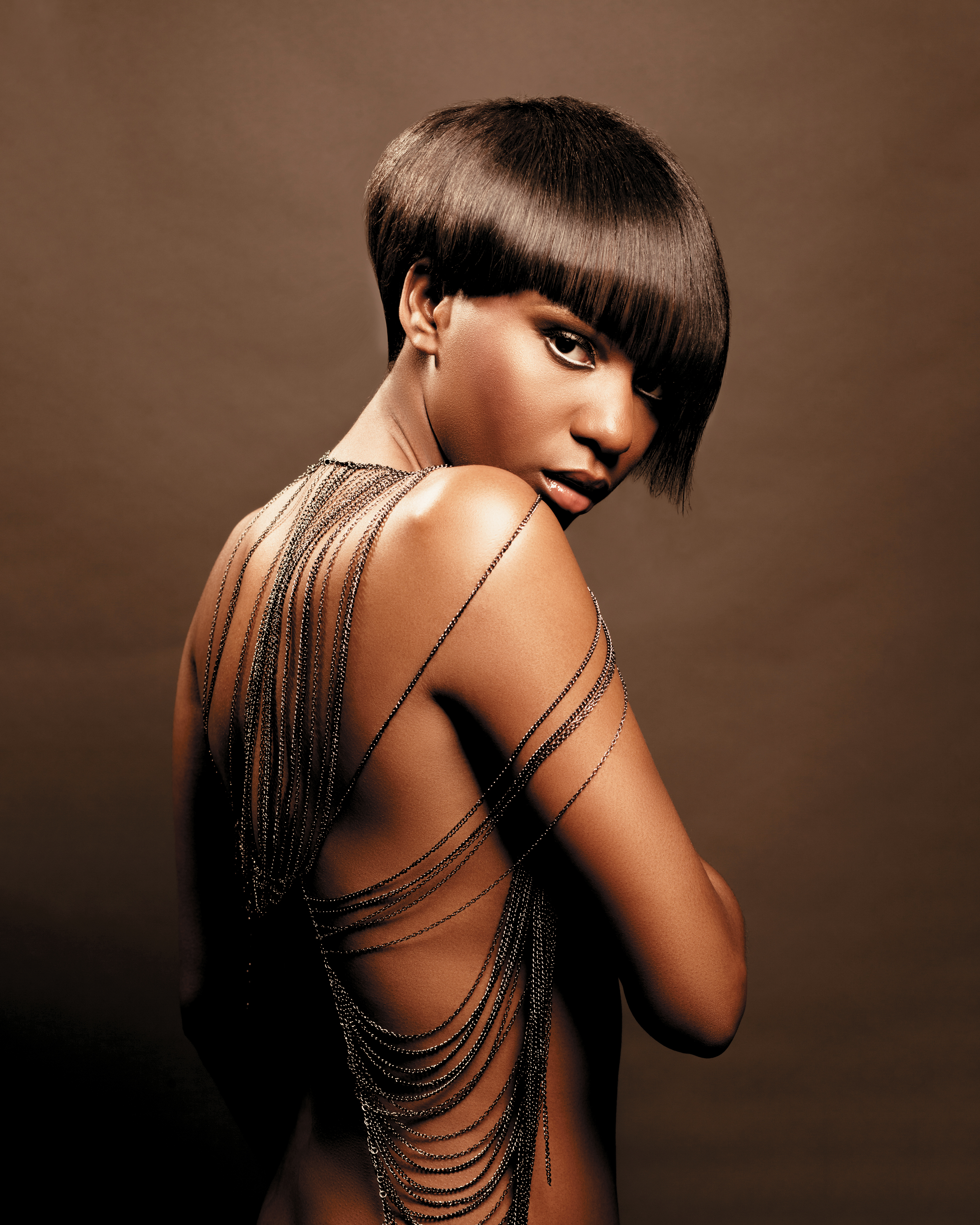 A graduated bob with an asymmetric fringe was blow-dried and finished with ceramic irons to create maximum shine.