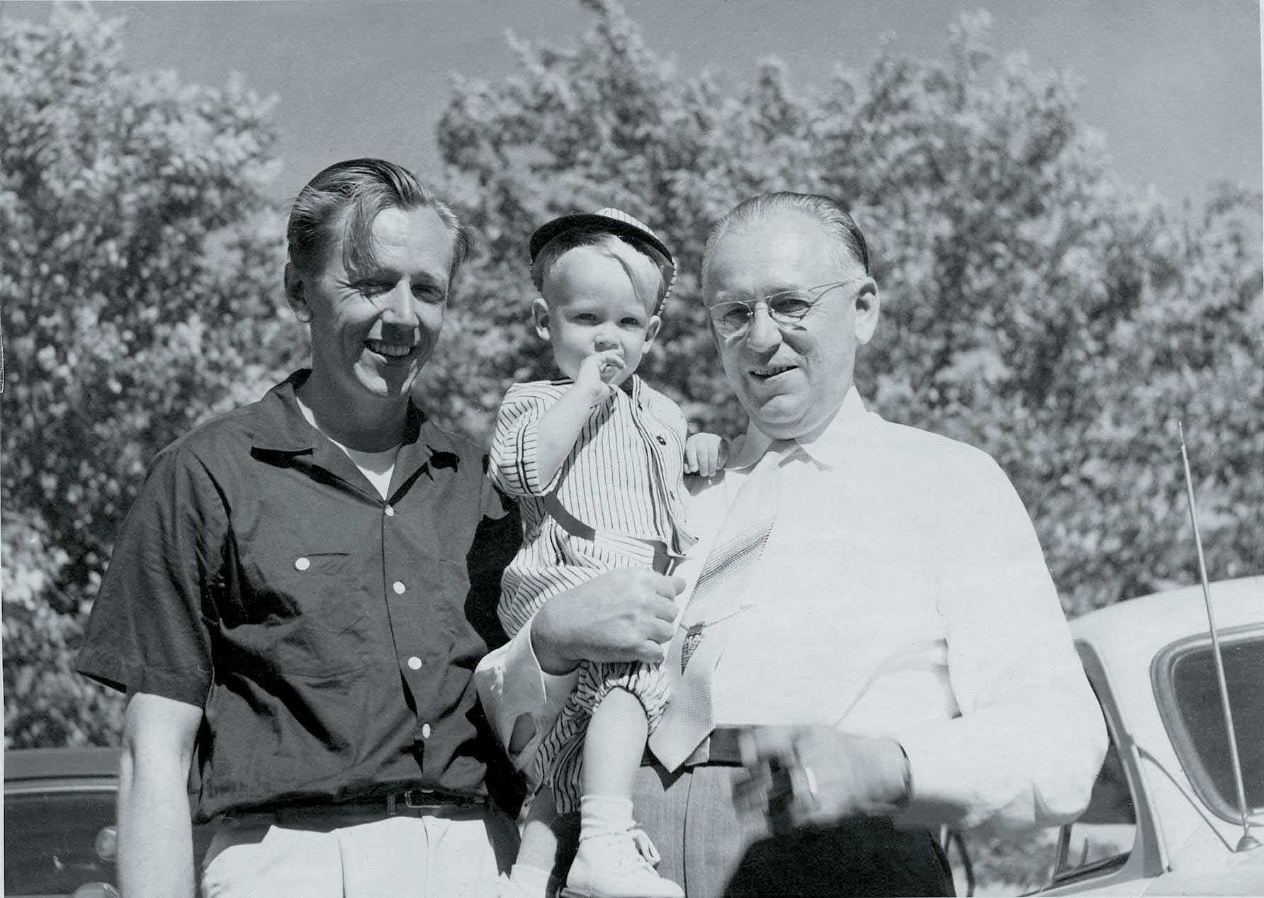 Charles Schulz with his father and son, Monte, circa 1953.