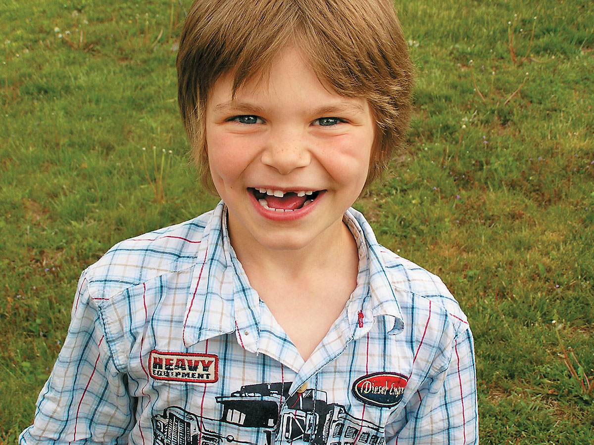 My grandson Evan at five—that smile, those dimples, they still bring a smile to my face.