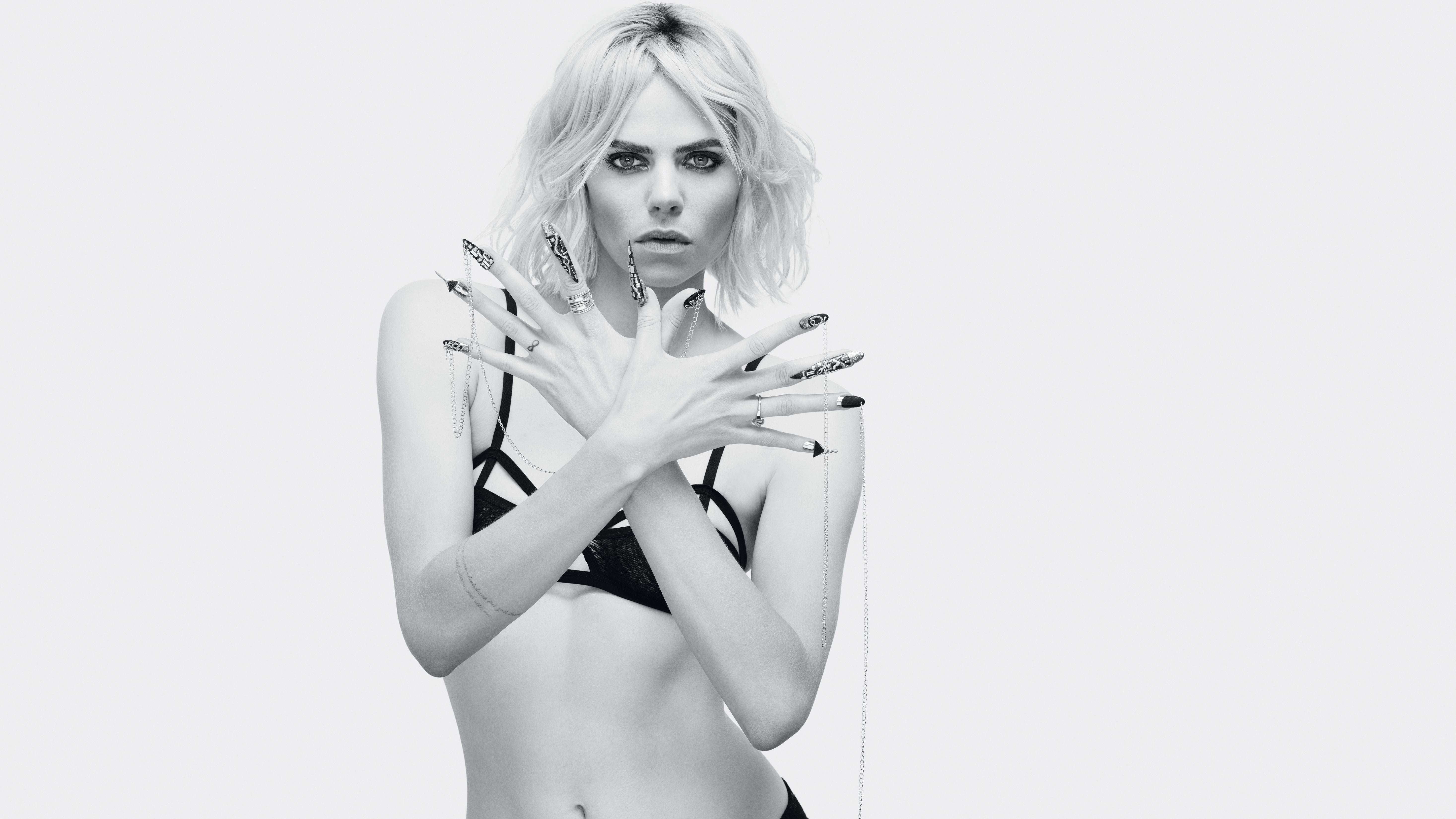 The longest over-the-top nails, which were seen on the runway for fall at Libertine, were created with Liquid & Powder, Brisa Gel, Shellac and Vinylux Weekly Polish. Shark teeth were fashioned with Liquid & Powder, while drips were made of Brisa Gel. Metal plates were affixed, nails pierced, chains attached. Now she's really ready for les liaisons dangereuses.